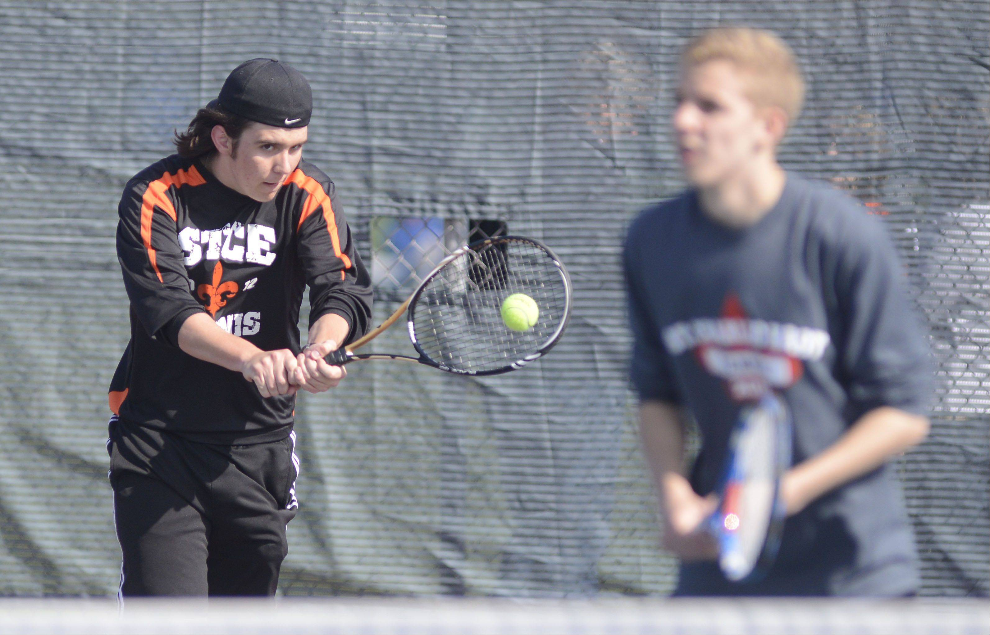 St. Charles East's George Spoerl, left, and teammate Matt McCarthy in first doubles match vs. Glenbard West's Kenny Reick and Jack Kellenberger at West Aurora High School on Saturday, April 27.