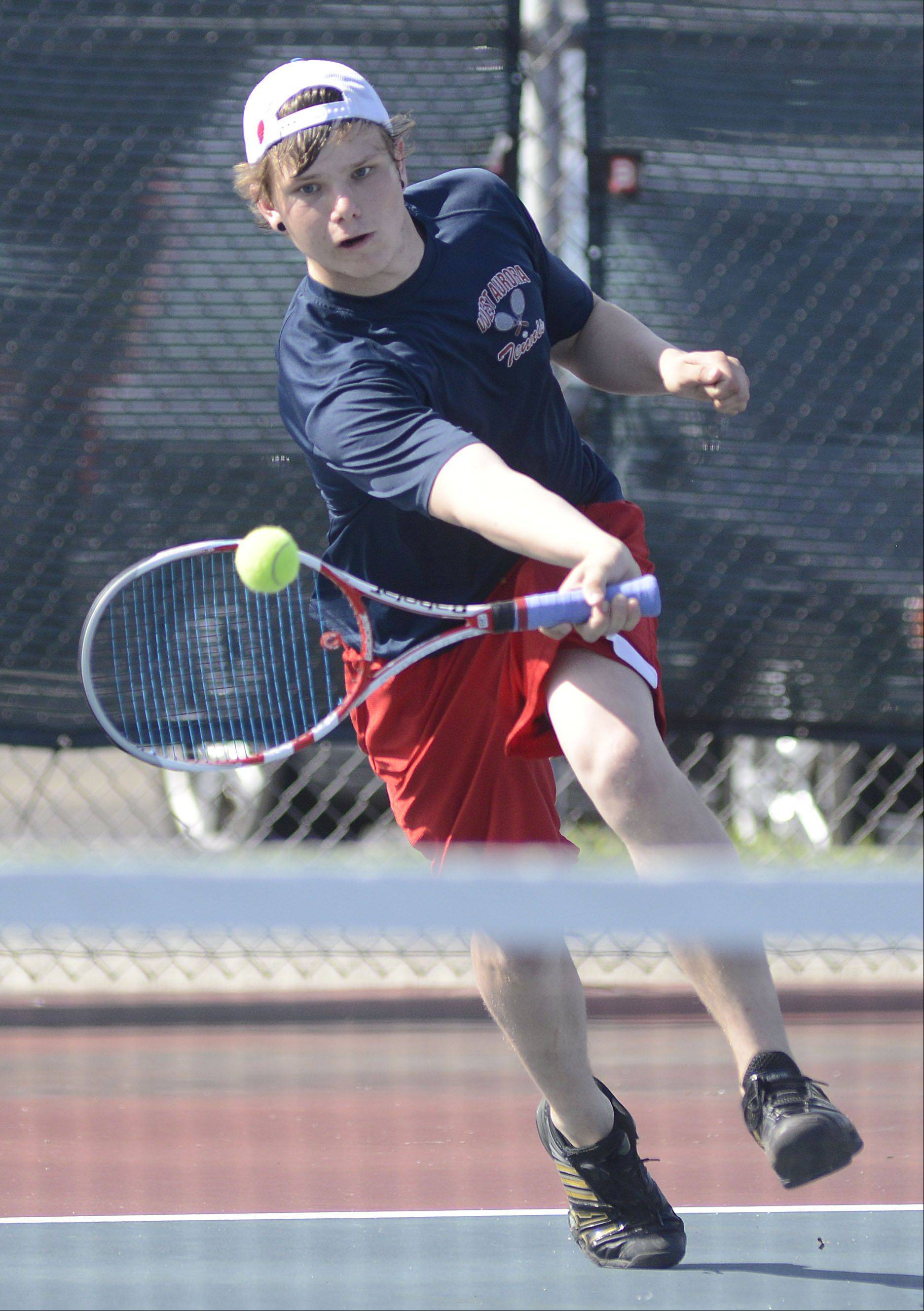 West Aurora's Nick Kuntzi in the first singles match vs. Marmion's John King at West Aurora High School on Saturday, April 27.