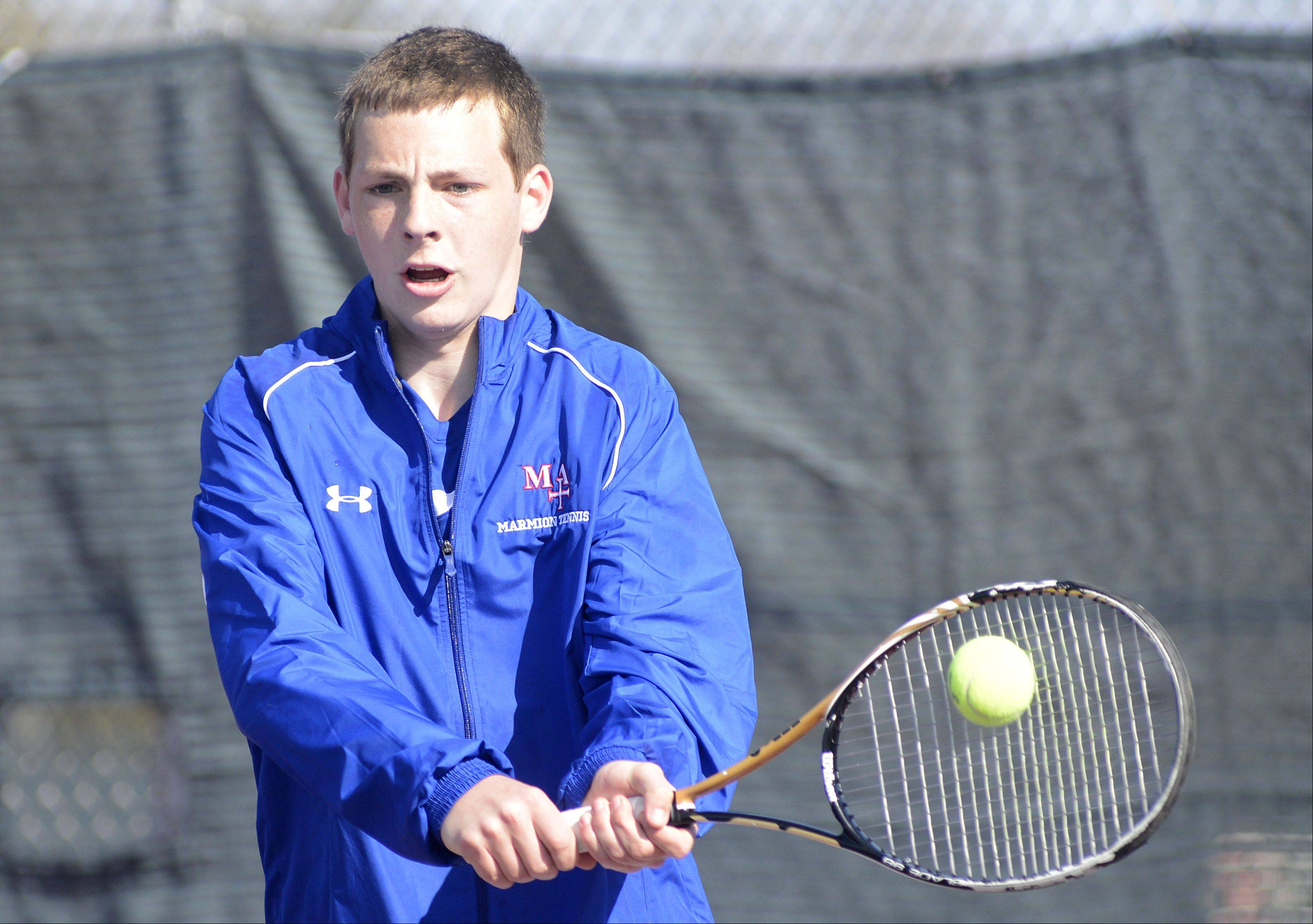 Marmion's John King vs. West Aurora's Nick Kuntzi in the first singles match at West Aurora High School on Saturday, April 27.