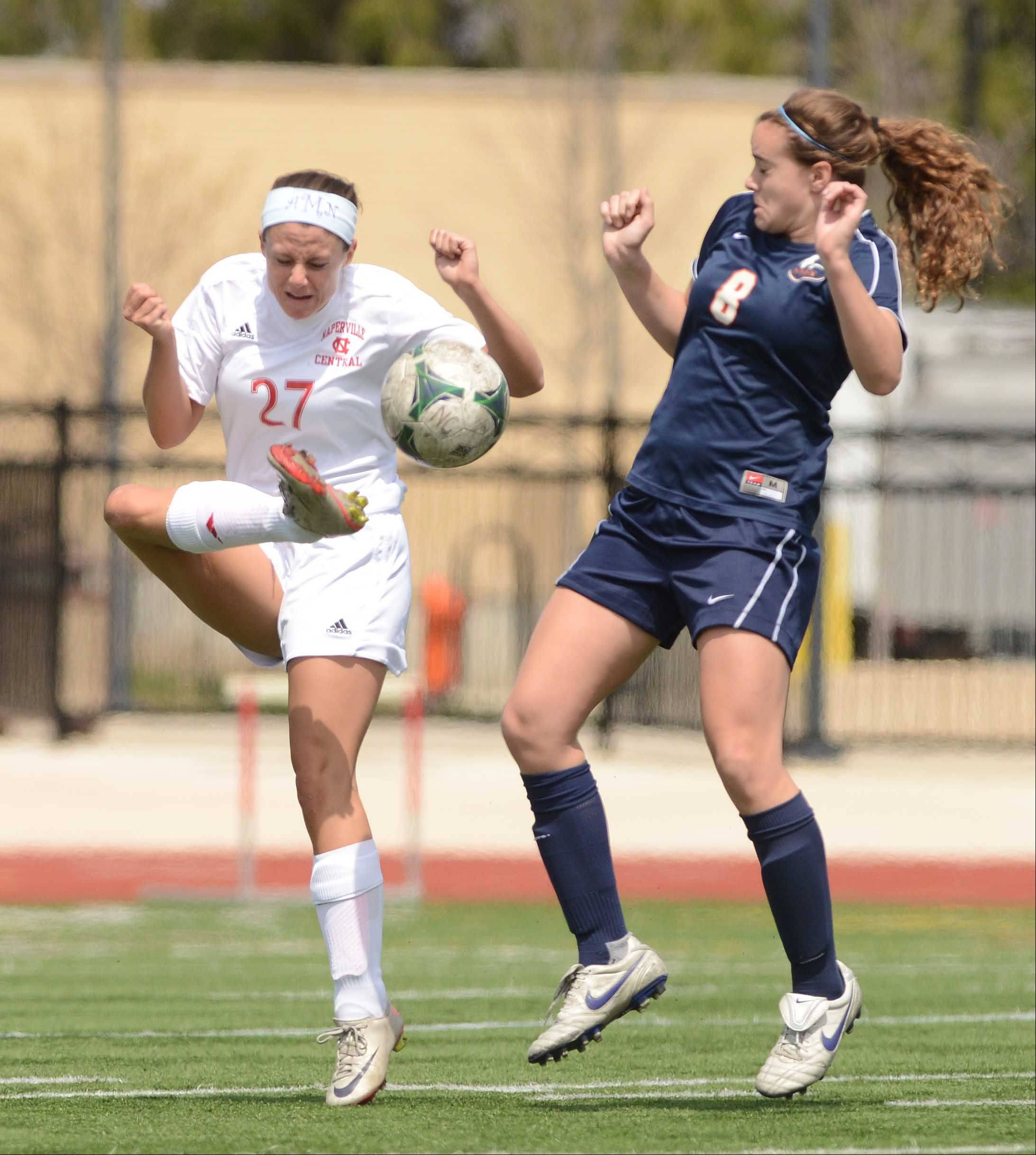 Amanda Alberts of Naperville Central,left, and Abbie Boswell of Naperville North bothe played during the Naperville Invitational Championship game Saturday at Naperville Central.