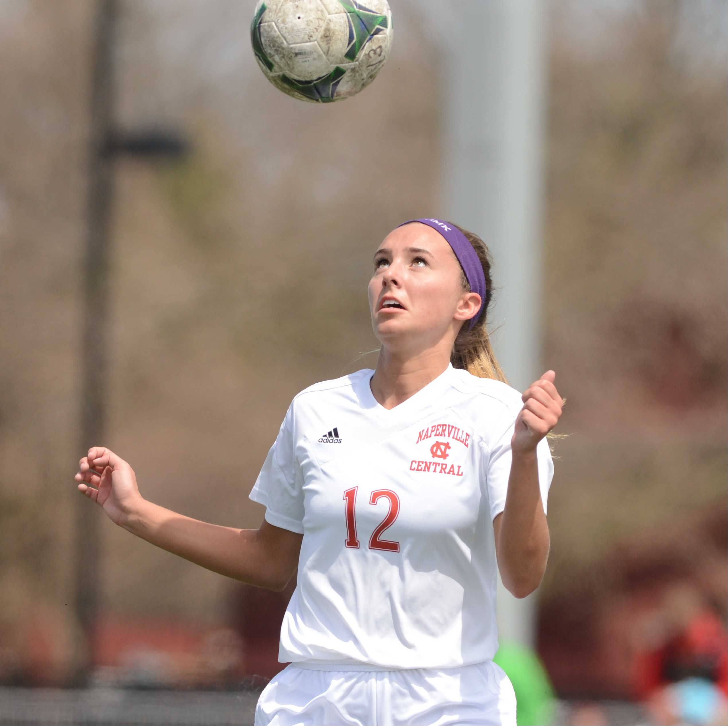 Veronica Ellis of Naperville Central lines up a ball to head during the Naperville Invitational Championship game Saturday. They played Naperville North.
