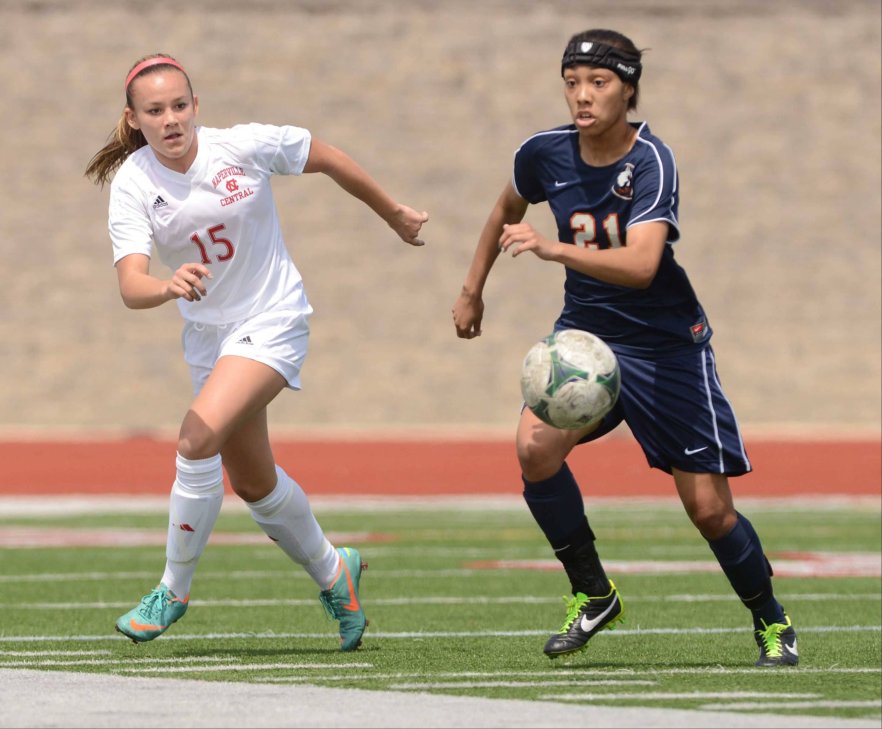 Kayla Rowan of Naperville Central,left, and Zoe Swift of Naperville North chae a ball during the Naperville Invitational championship game Saturday.