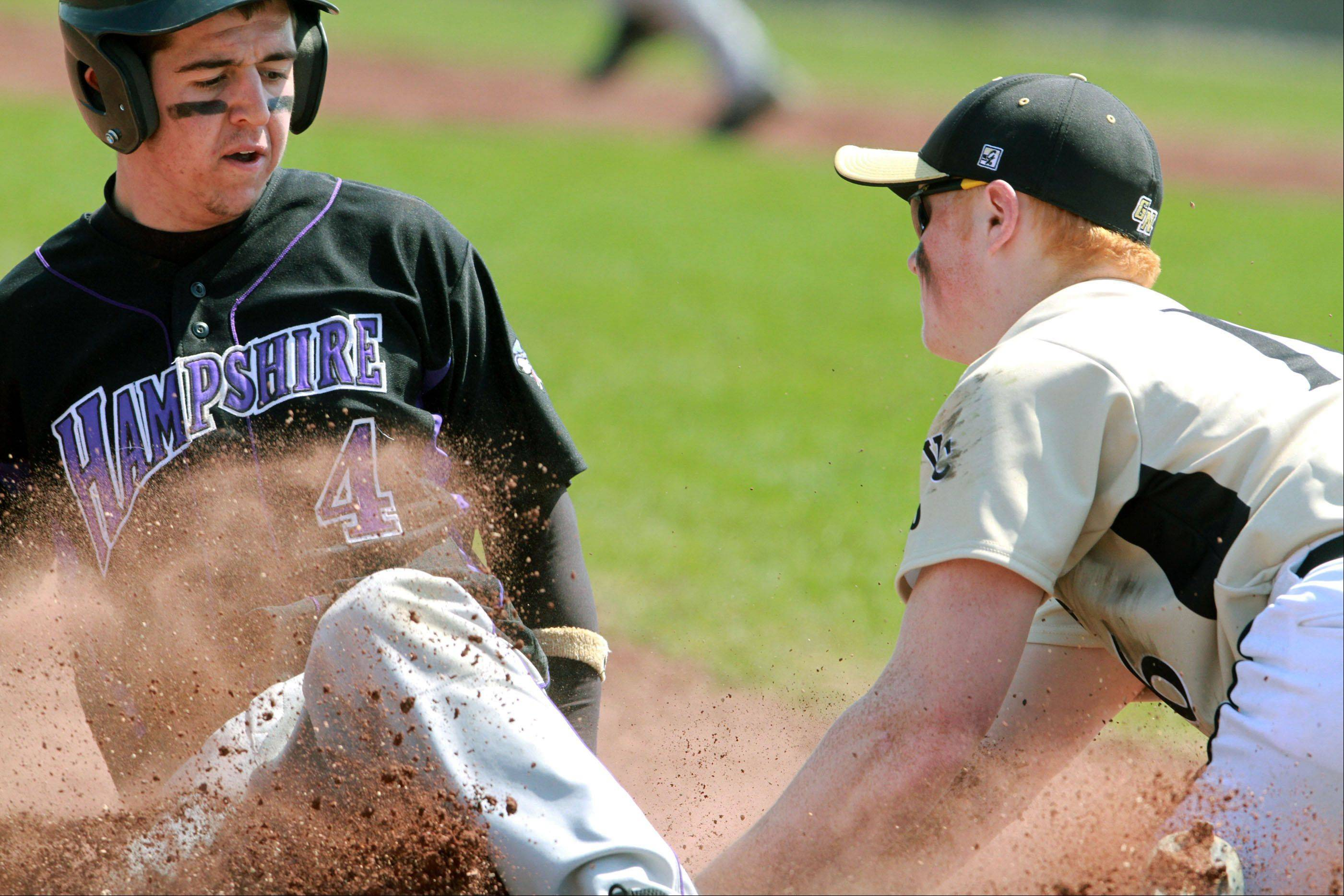 Hampshire's Michael Laramie is out at third as Grayslake North third-baseman Merrick Gentile applies the tag at Grayslake North on Saturday.