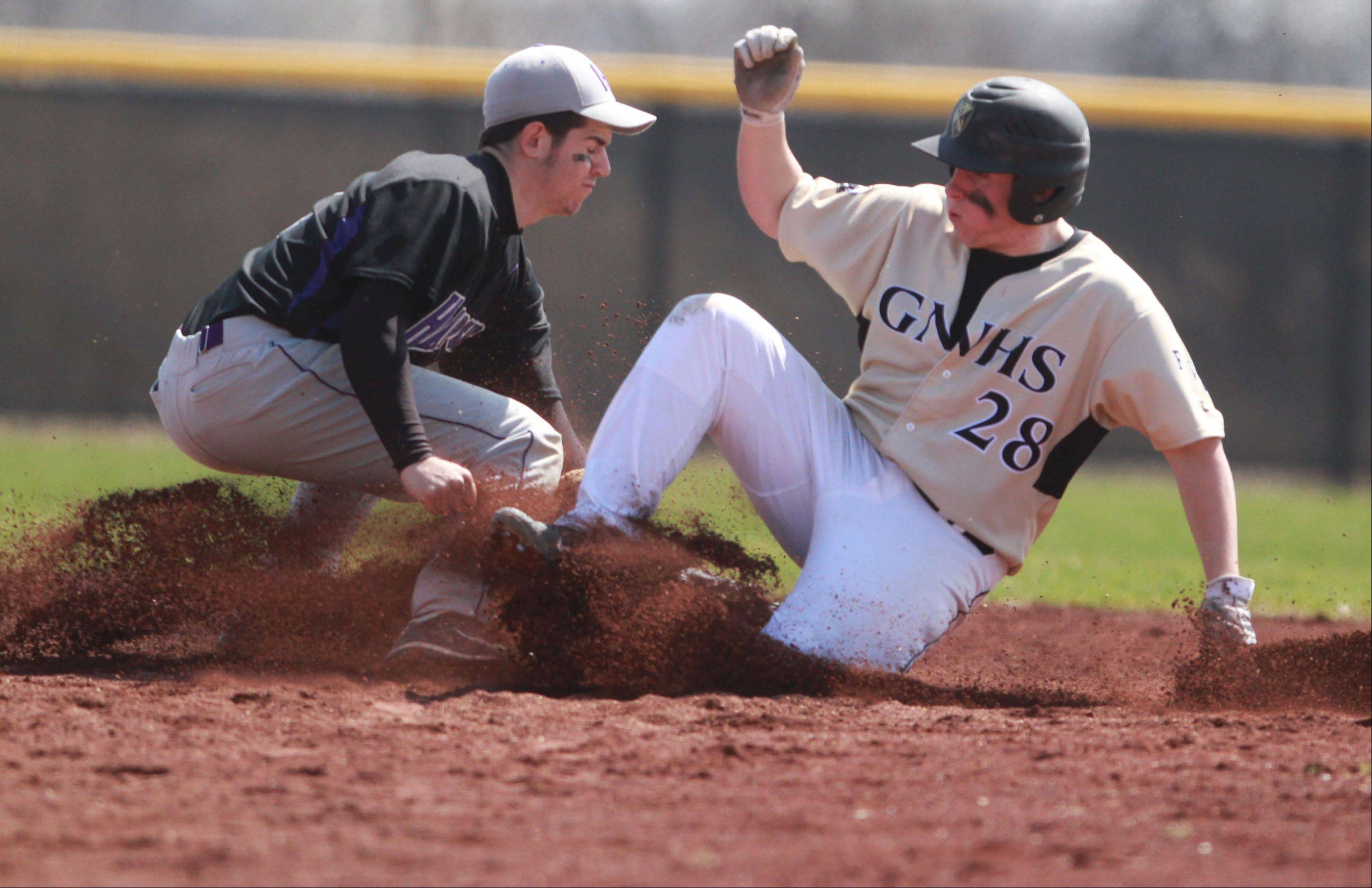 Grayslake North's Adam Gomski is safe at second as Hampshire shortstop Michael Laramie applies the tag at Grayslake North on Saturday.
