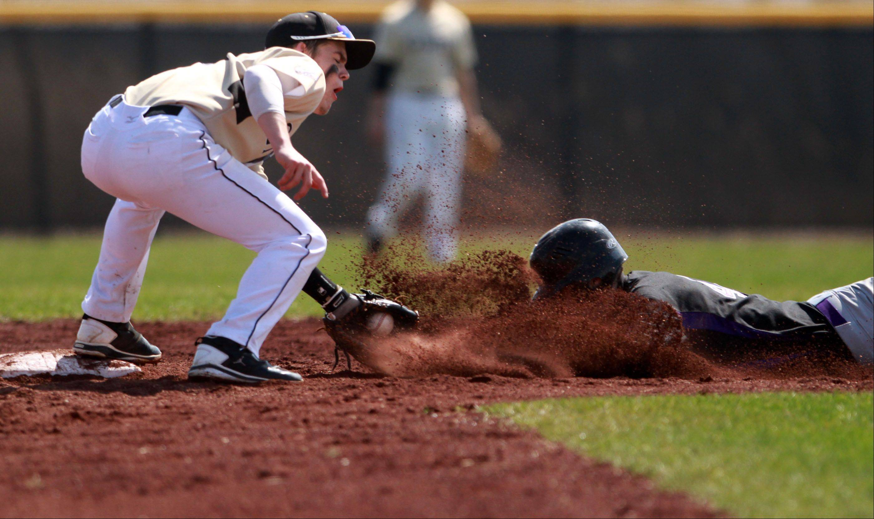 Hampshire's Tyler Crater is safe at second base as Grayslake North second baseman Nick Carmody applies the tag at Grayslake North on Saturday.