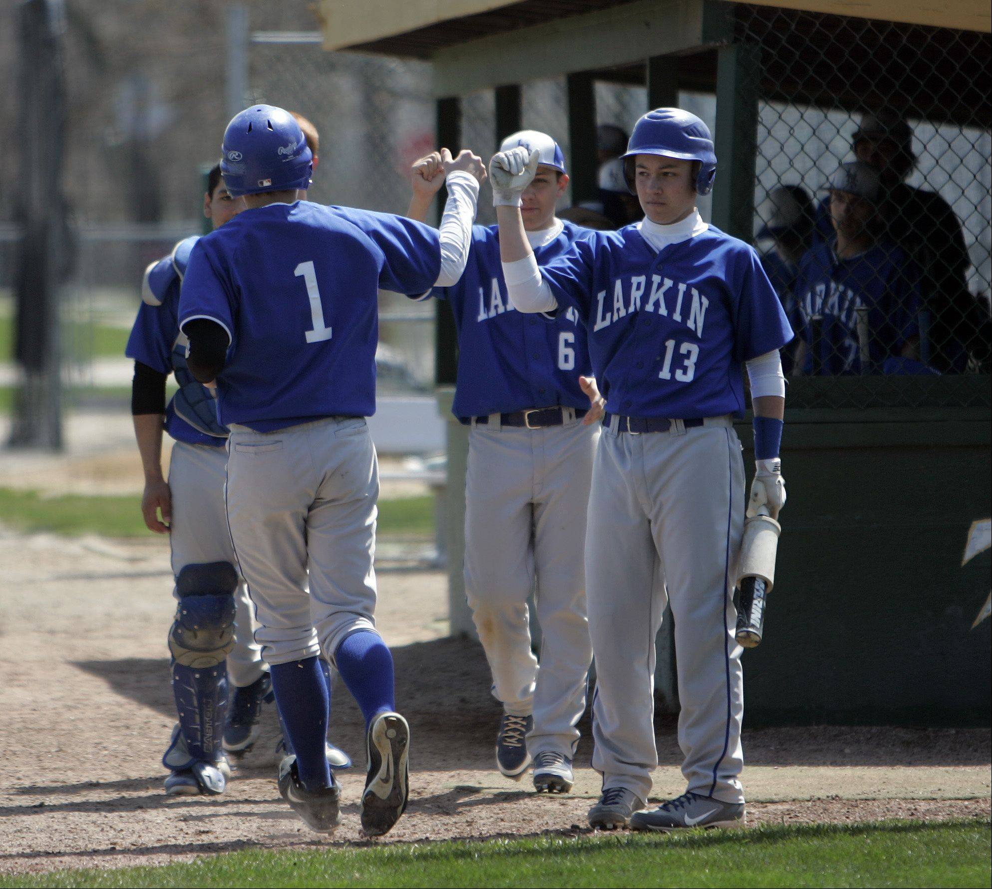 Larkin's Rob Bond is greeted by his teammates after scoring against Elgin Saturday at Trout Park.