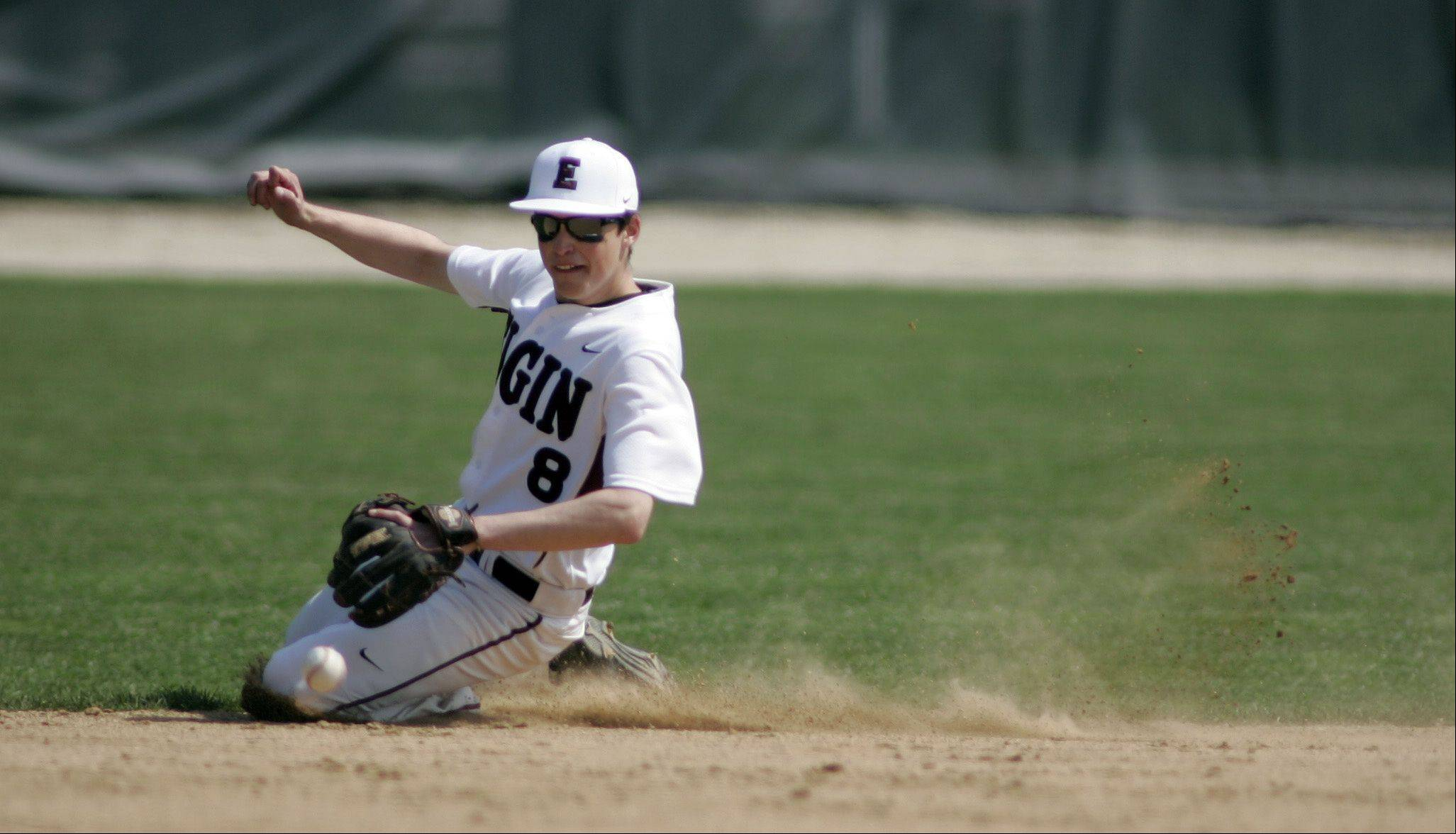 Elgin's Alex Buttell reels in a ground ball Saturday at Trout Park.