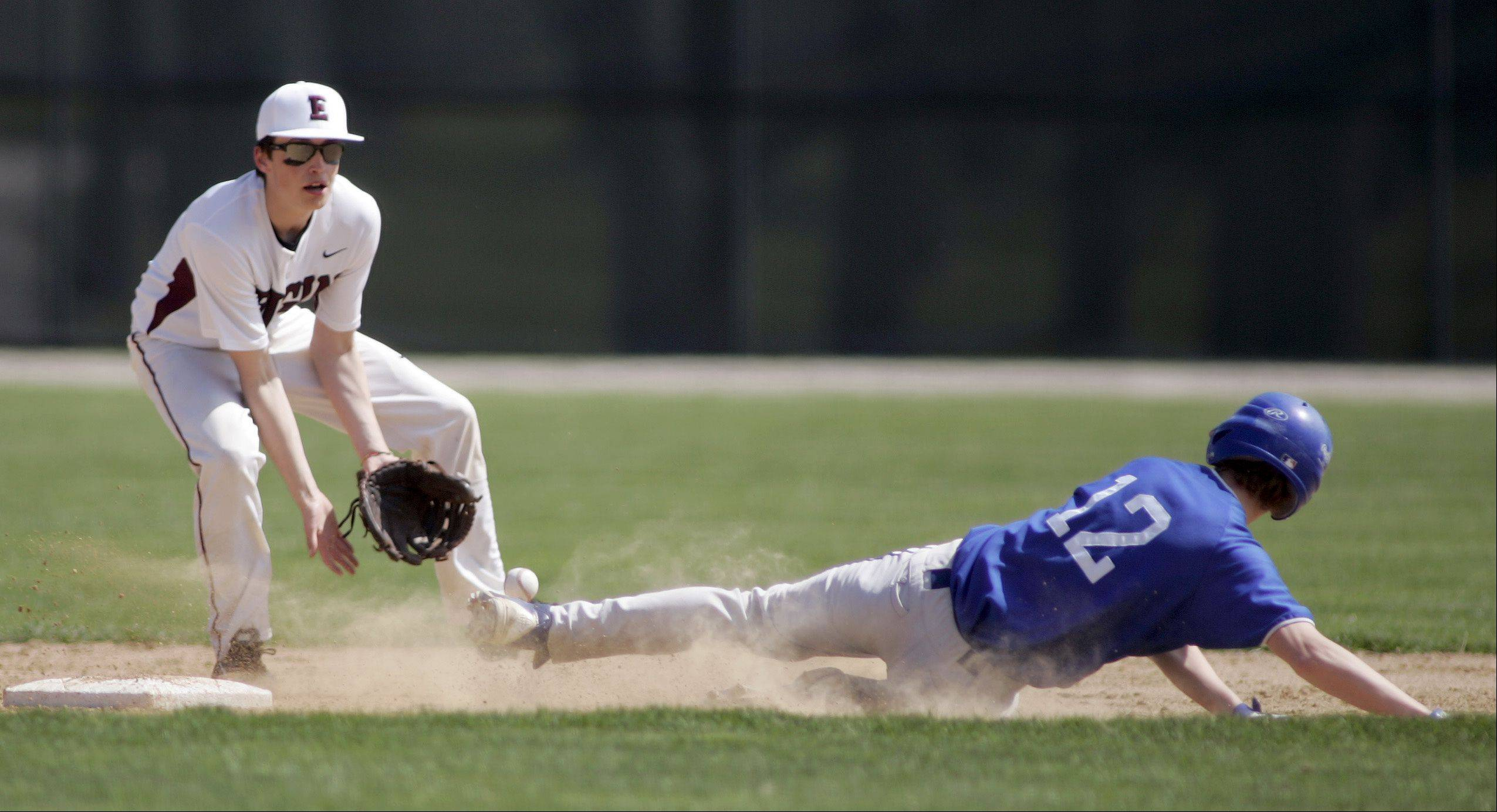 Elgin's Alex Buttell tries to pull in the throw to second as Larkin's Jack McCracken slides in safely Saturday at Trout Park.