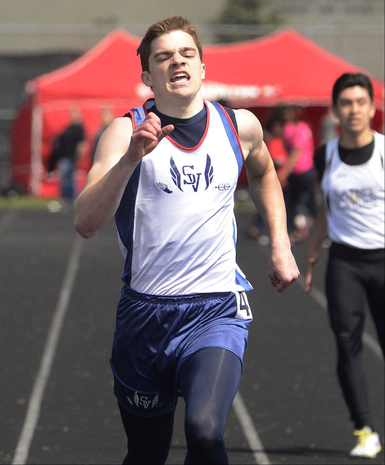 John Balas of St. Viator finishing second in his heat of the 400 dash at the Palatine Relays.