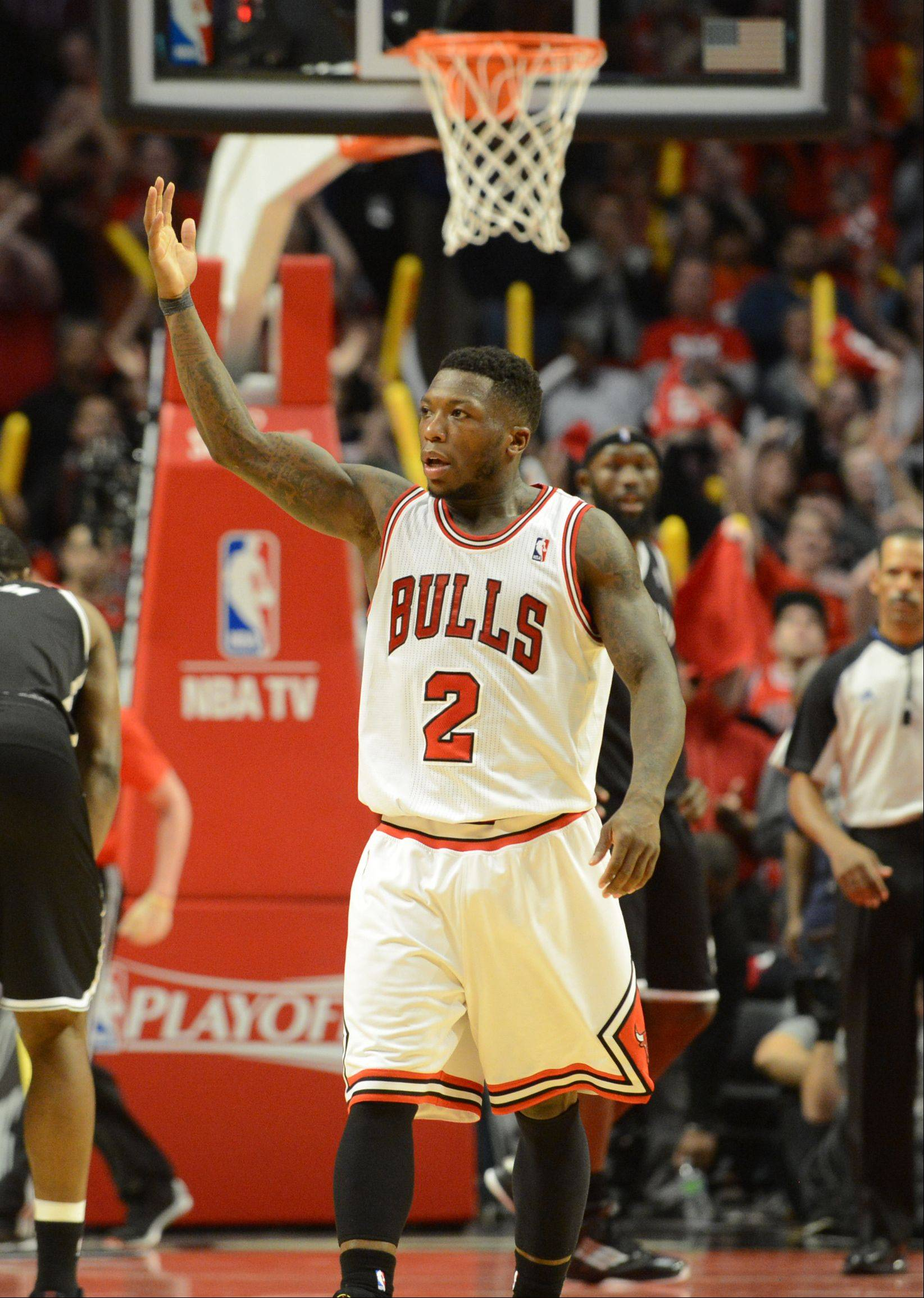 Nate Robinson gets the crowed fired up in the third overtime Saturday during game 4 of the first round playoff game against the Brooklyn Nets at the United Center. The Bulls won 142-134.
