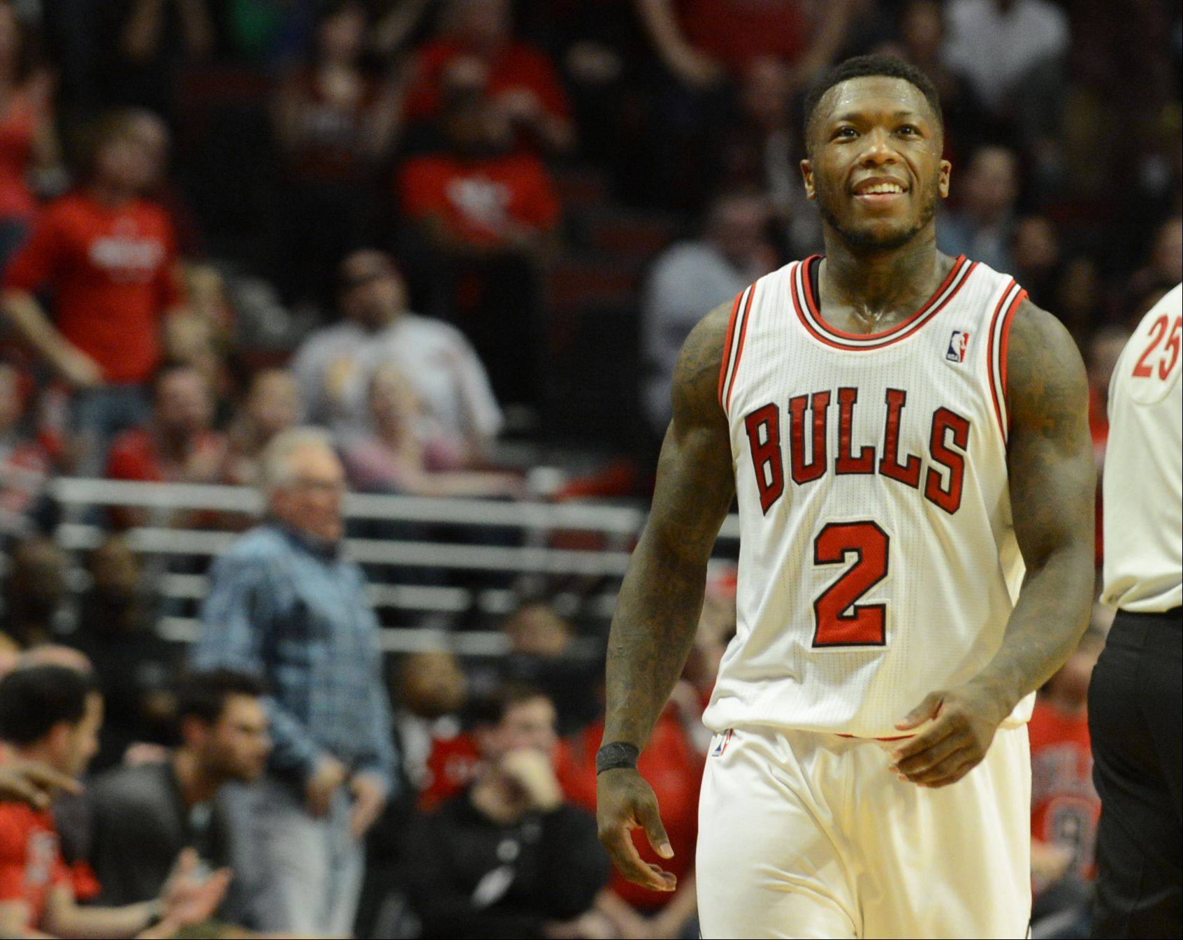 Nate Robinson is all smiles as he heads up court after making a basket in the second overtime Saturday during game 4 of the first round playoff game against the Brooklyn Nets at the United Center. The Bulls won in triple overtime 142-134