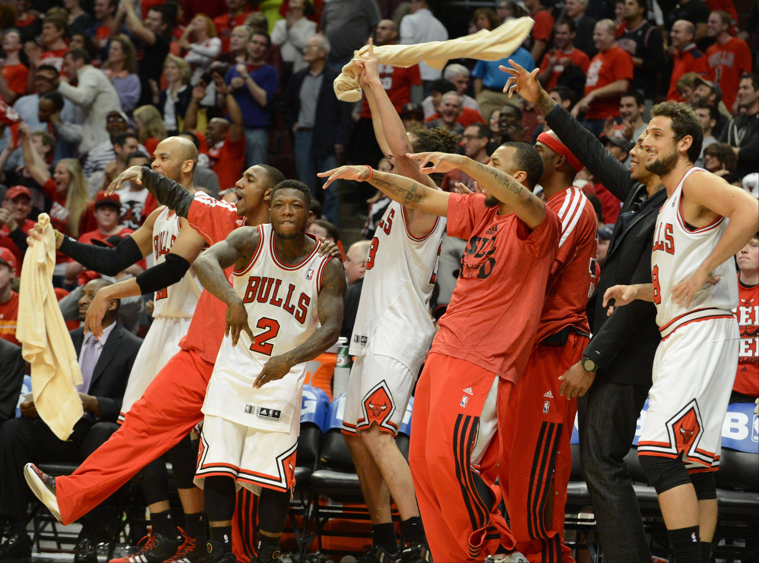 The Bulls bench is fired up late in the third overtime as the Bulls took the lead Saturday during game 4 of the first round playoff game against the Brooklyn Nets at the United Center. The Bulls won 142-134.
