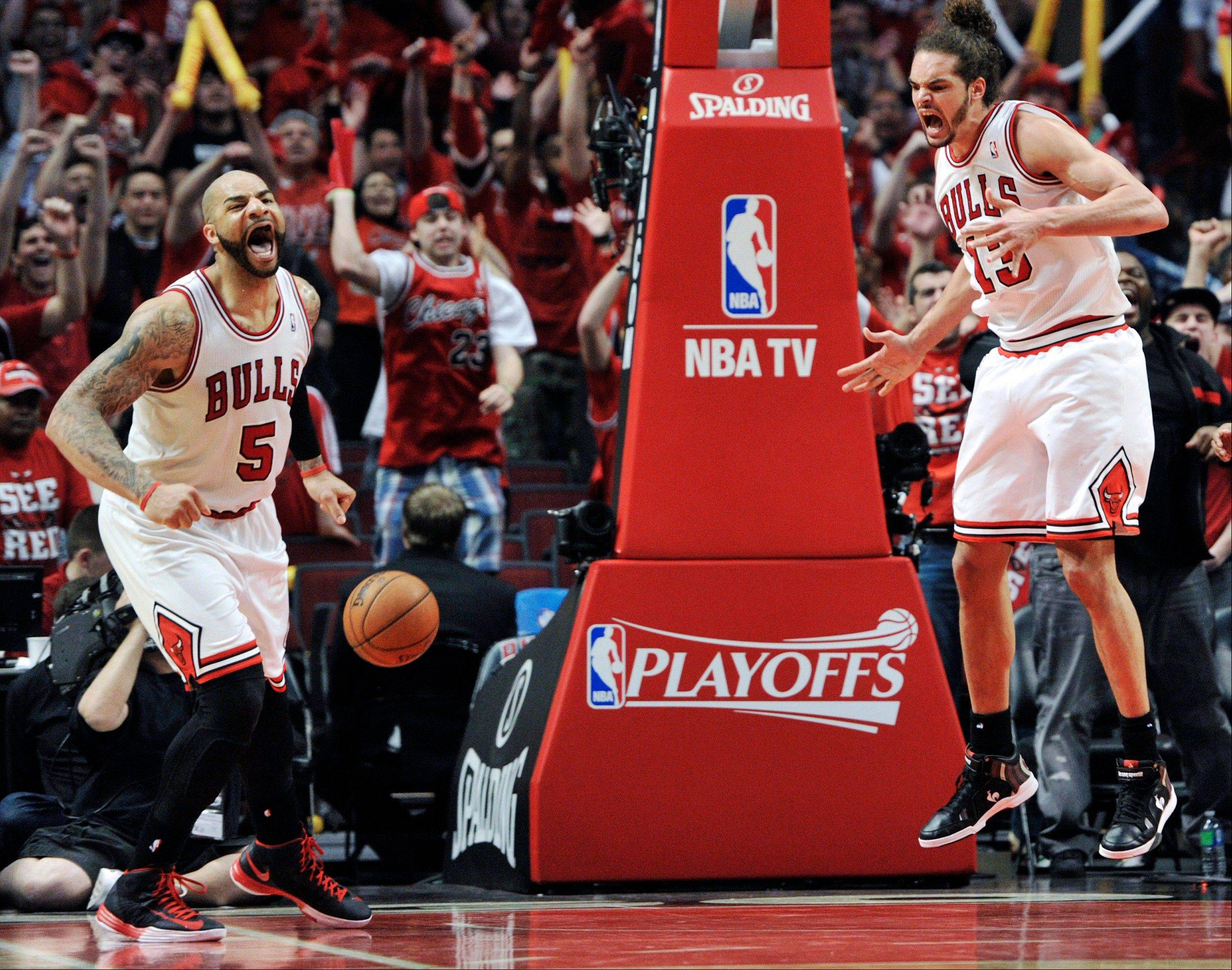 Chicago Bulls' Carlos Boozer (5) and Joakim Noah (13) celebrate a basket against the Brooklyn Nets during the second overtime in Game 4 of their first-round NBA basketball playoff series Saturday, April 27, 2013, in Chicago. The Bulls won 142-134 in three overtimes.