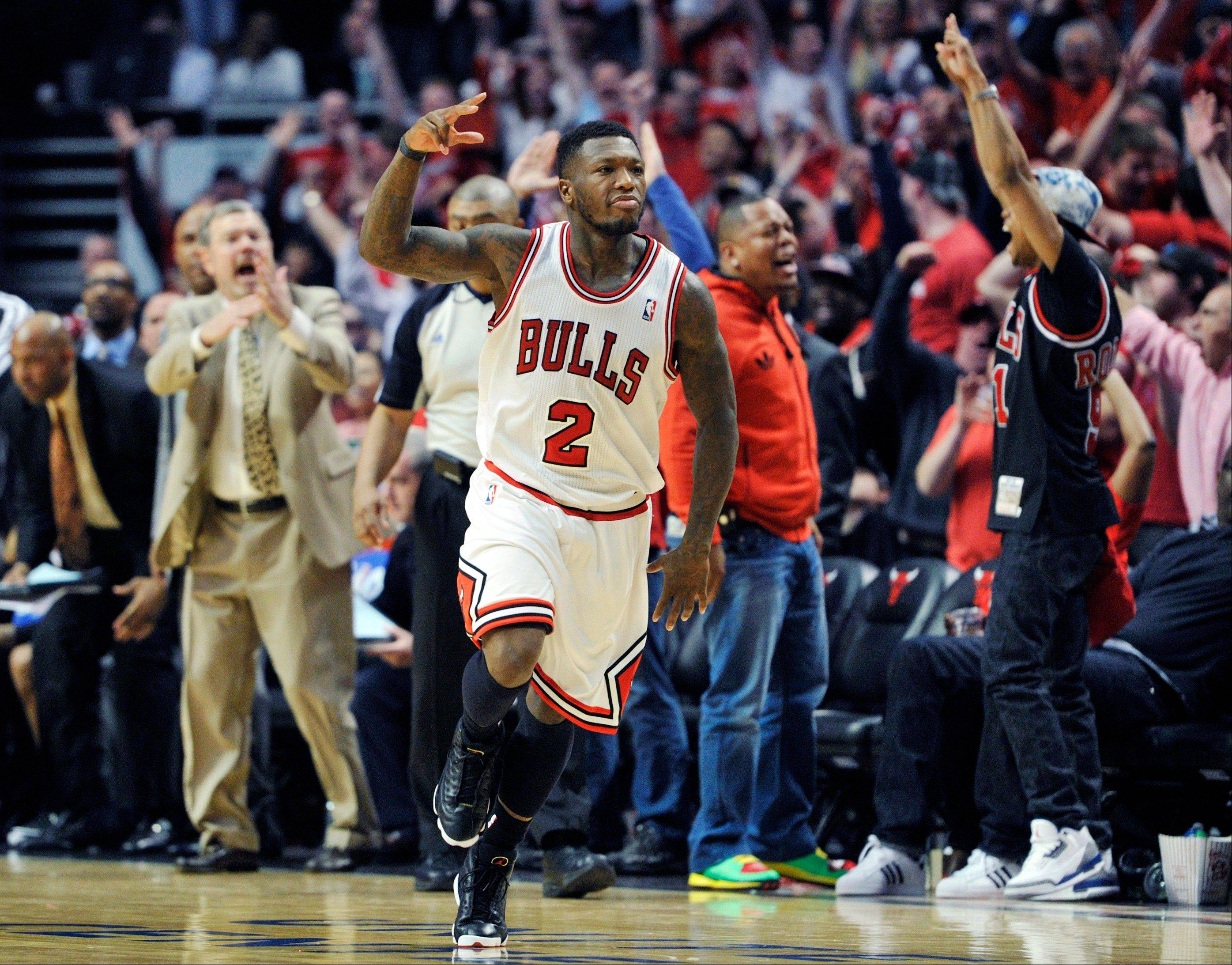 Chicago Bulls' Nate Robinson (2) celebrates a basket against the Brooklyn Nets during the second overtime in Game 4 of their first-round NBA basketball playoff series Saturday, April 27, 2013, in Chicago. The Bulls won 142-134 in three overtimes.