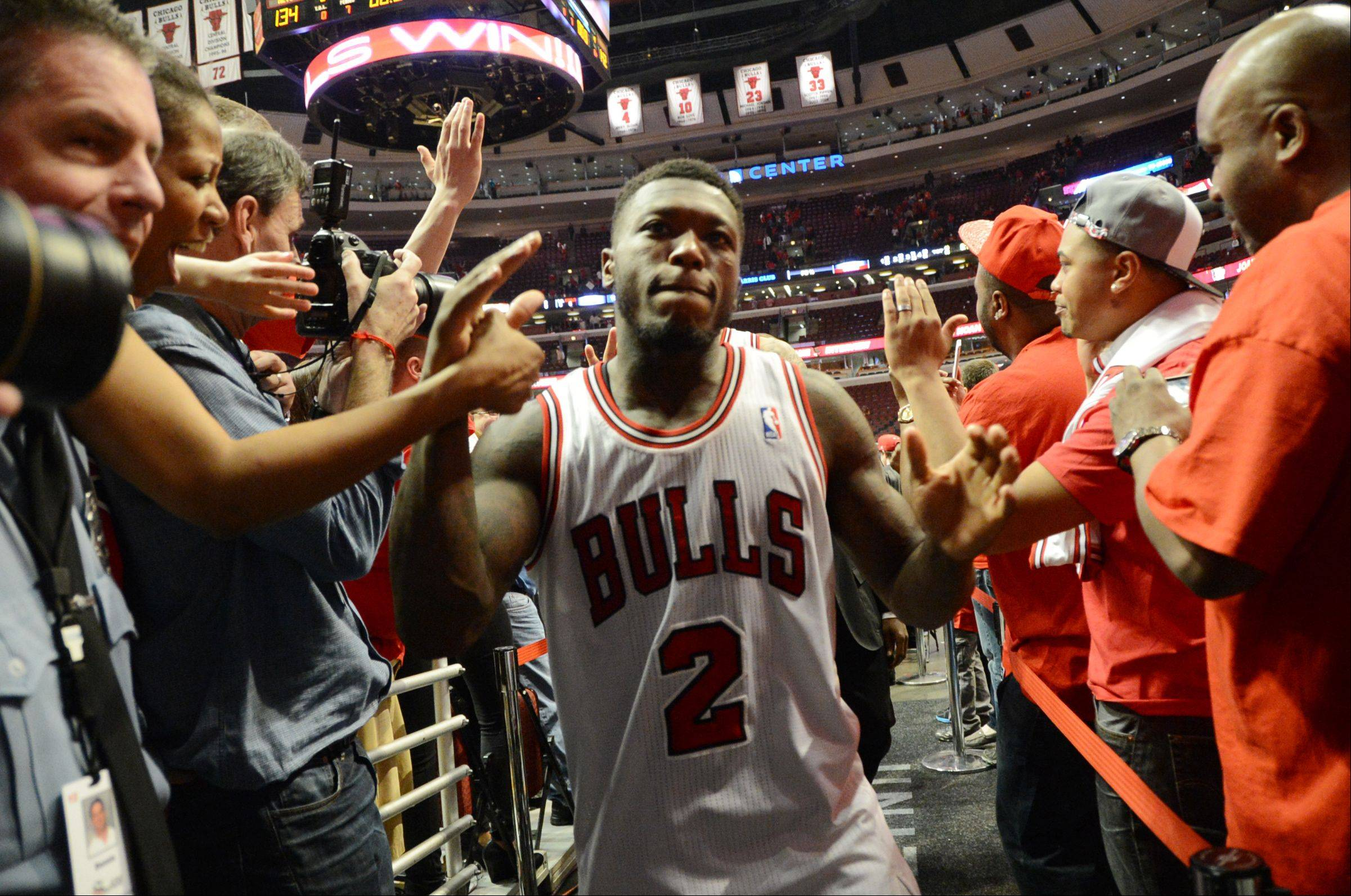 The Bulls Nate Robinson is greeted by fans as he comes off of the court Saturday during game 4 of the first round playoff game against the Brooklyn Nets at the United Center. Robinson was a big part of the Bulls triple overtime victory over the Brooklyn Nets.