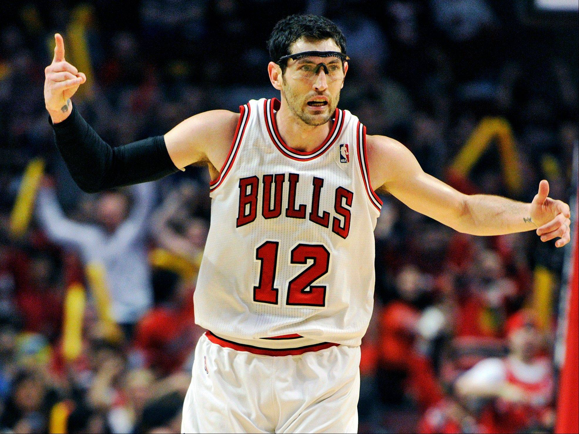 Chicago Bulls' Kirk Hinrich (12) celebrates a 3-point basket against the Brooklyn Nets during the first half in Game 4 of their first-round NBA basketball playoff series Saturday, April 27, 2013, in Chicago.