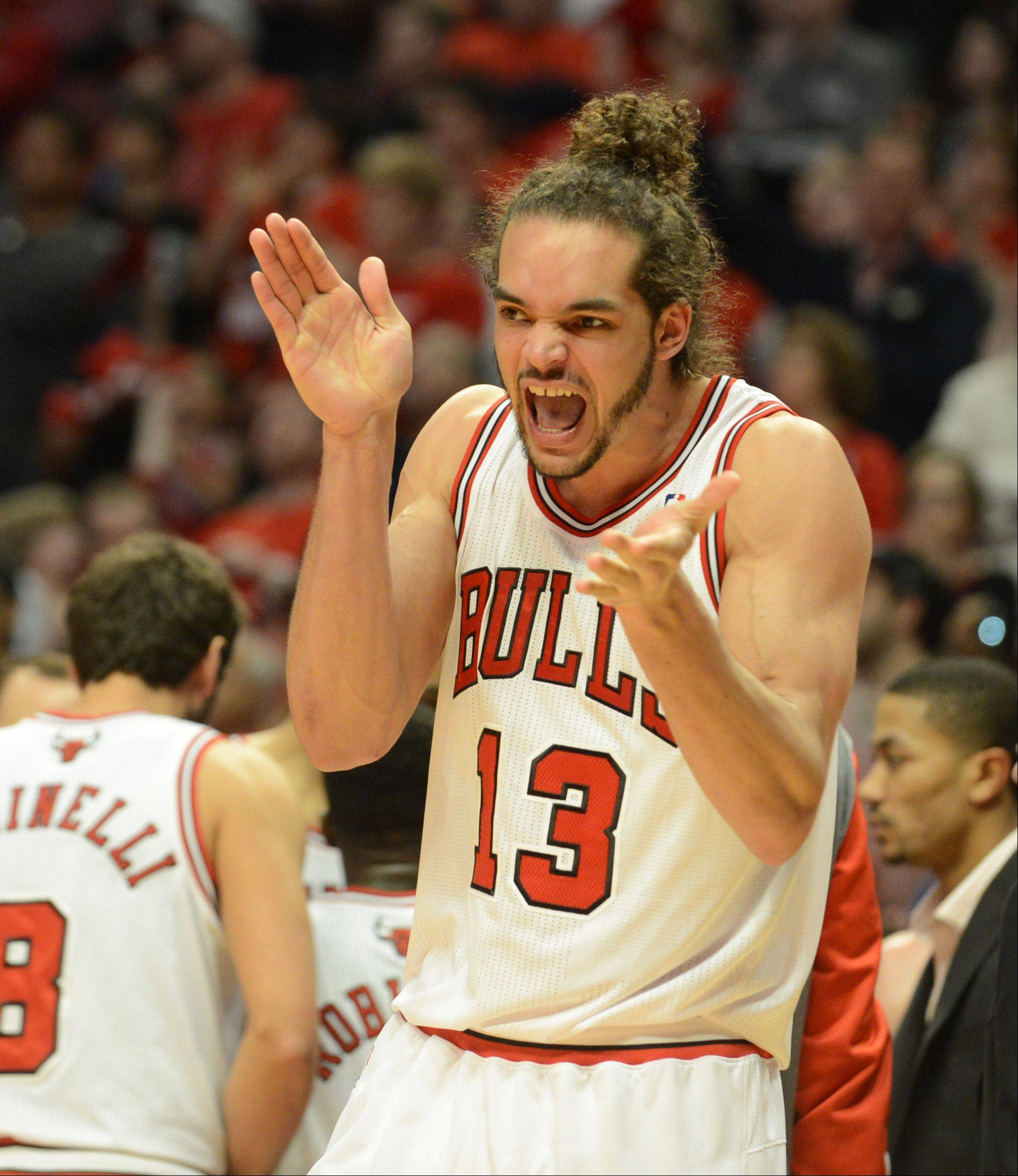 Joakim Noah gets the crowd going during the second quarter Saturday during game 4 of the first round playoff game against the Brooklyn Nets at the United Center. The Bulls won in triple overtime 142-134
