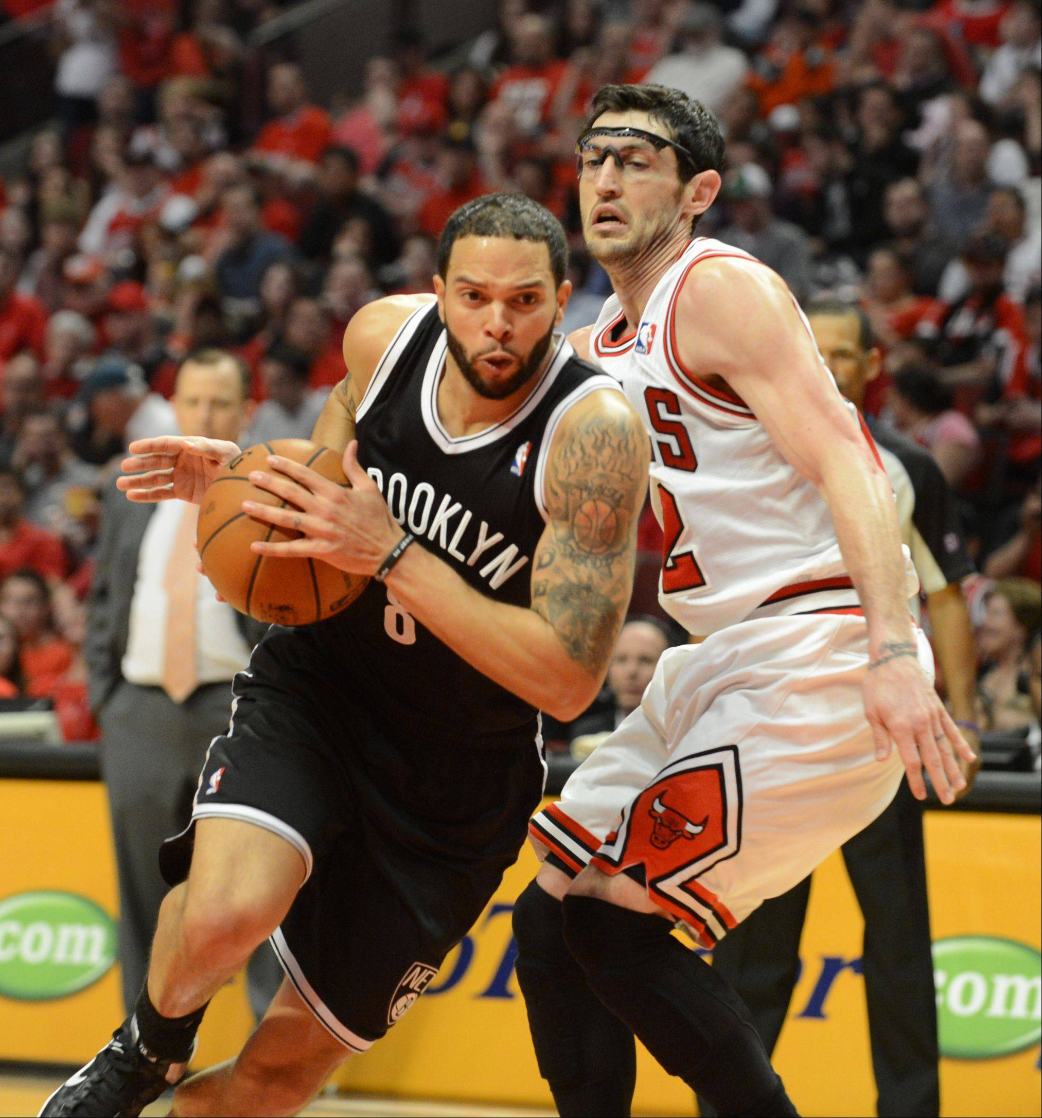 Brooklyn's Deron Williams drives to the basket past the Bulls Kirk Hinrich in the third quarter Saturday during game 4 of the first round playoff game against the Brooklyn Nets at the United Center. The Bulls won in triple overtime 142-134