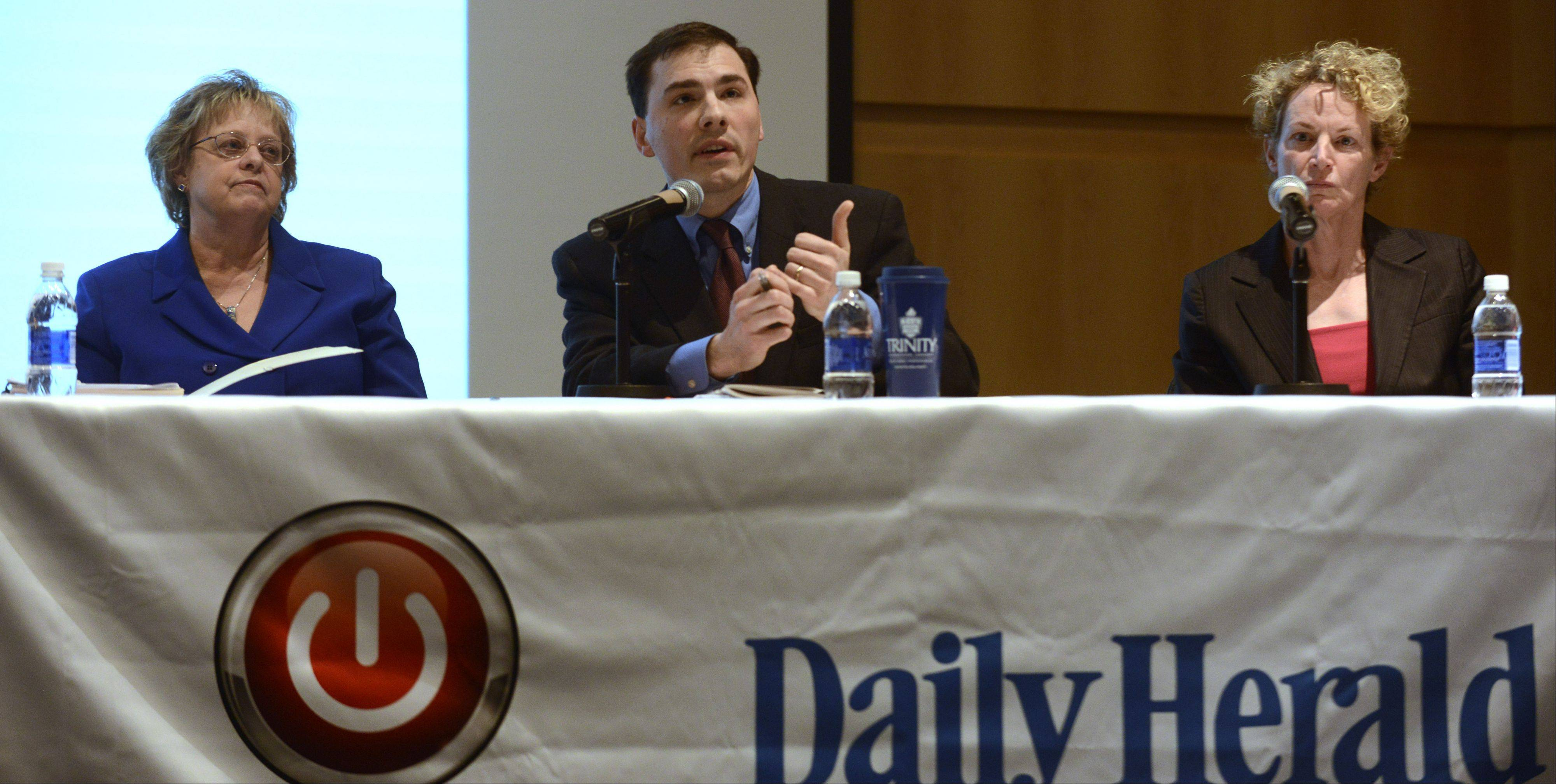 JOE LEWNARD/jlewnard@dailyherald.comLeft to right, Cinda Klickna, Illinois Education Association president, and state representatives Tom Morrison and Elaine Nekritz participate in a pension reform forum sponsored by the Daily Herald and Reboot Illinois, held at Harper College in Palatine Wednesday.