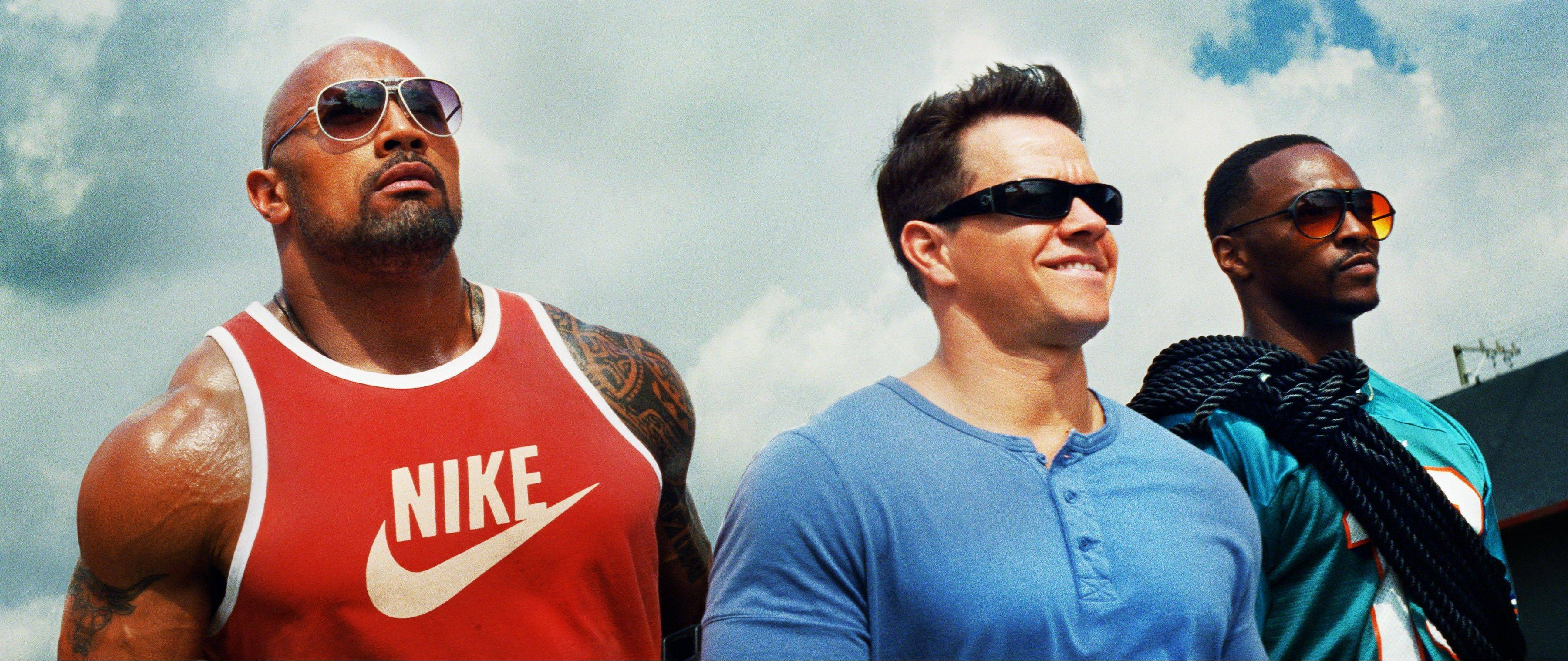 "Dwayne Johnson, left, as Paul Doyle, Mark Wahlberg as Daniel Lugo and Anthony Mackie as Adrian Doorbal star in ""Pain & Gain,"" which came in at No. 1 at the box office."