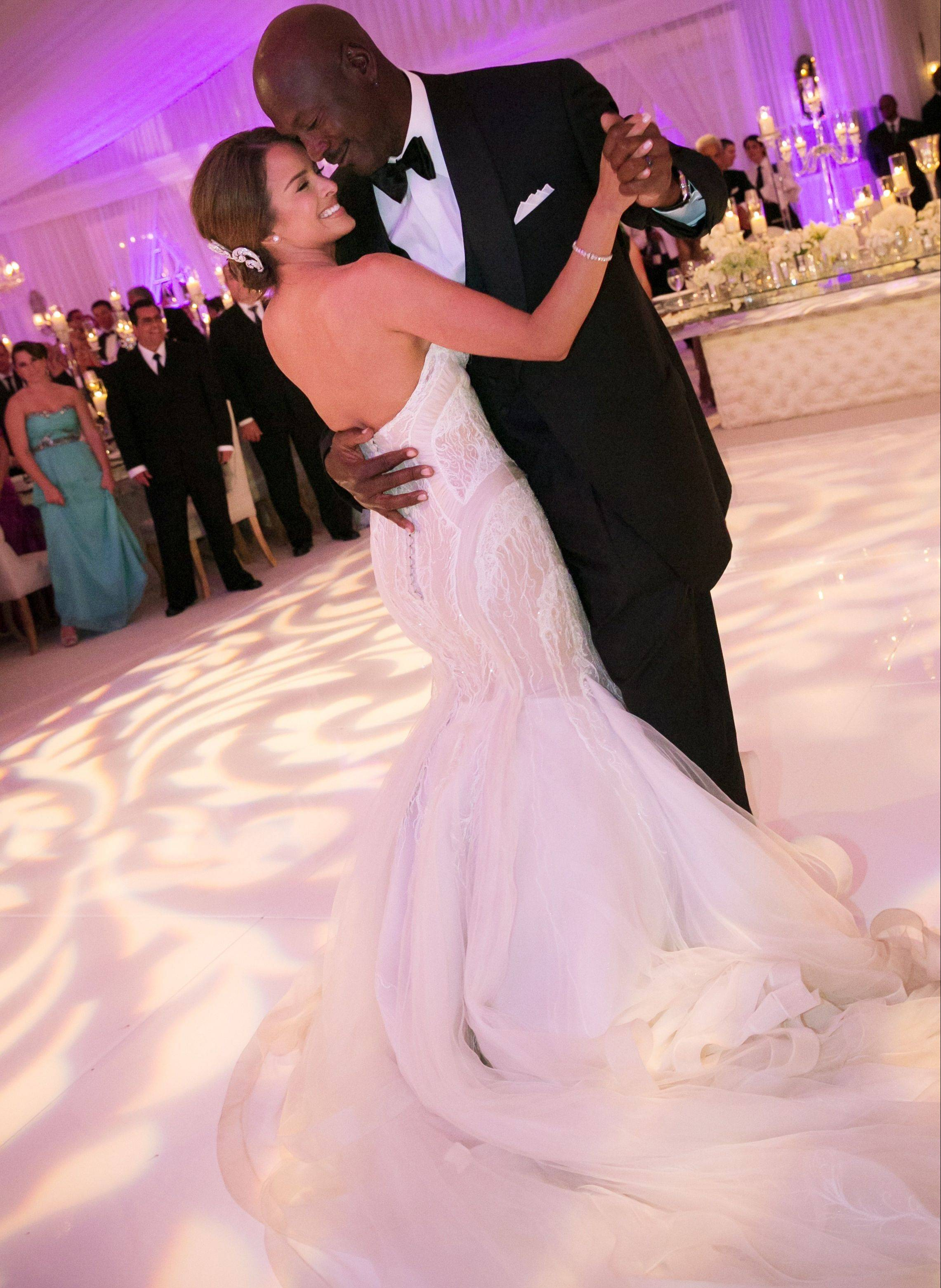 In this photo provided by JUMP.DC, Charlotte Bobcats owner Michael Jordan dances with his bride Yvette Prieto during their wedding reception Saturday night at the Bear's Club in Jupiter, Fla. More than 300 guests were in attendance, including Tiger Woods, Patrick Ewing and Ahmad Rashad, Jordan's manager Estee Portnoy told The Associated Press on Sunday.