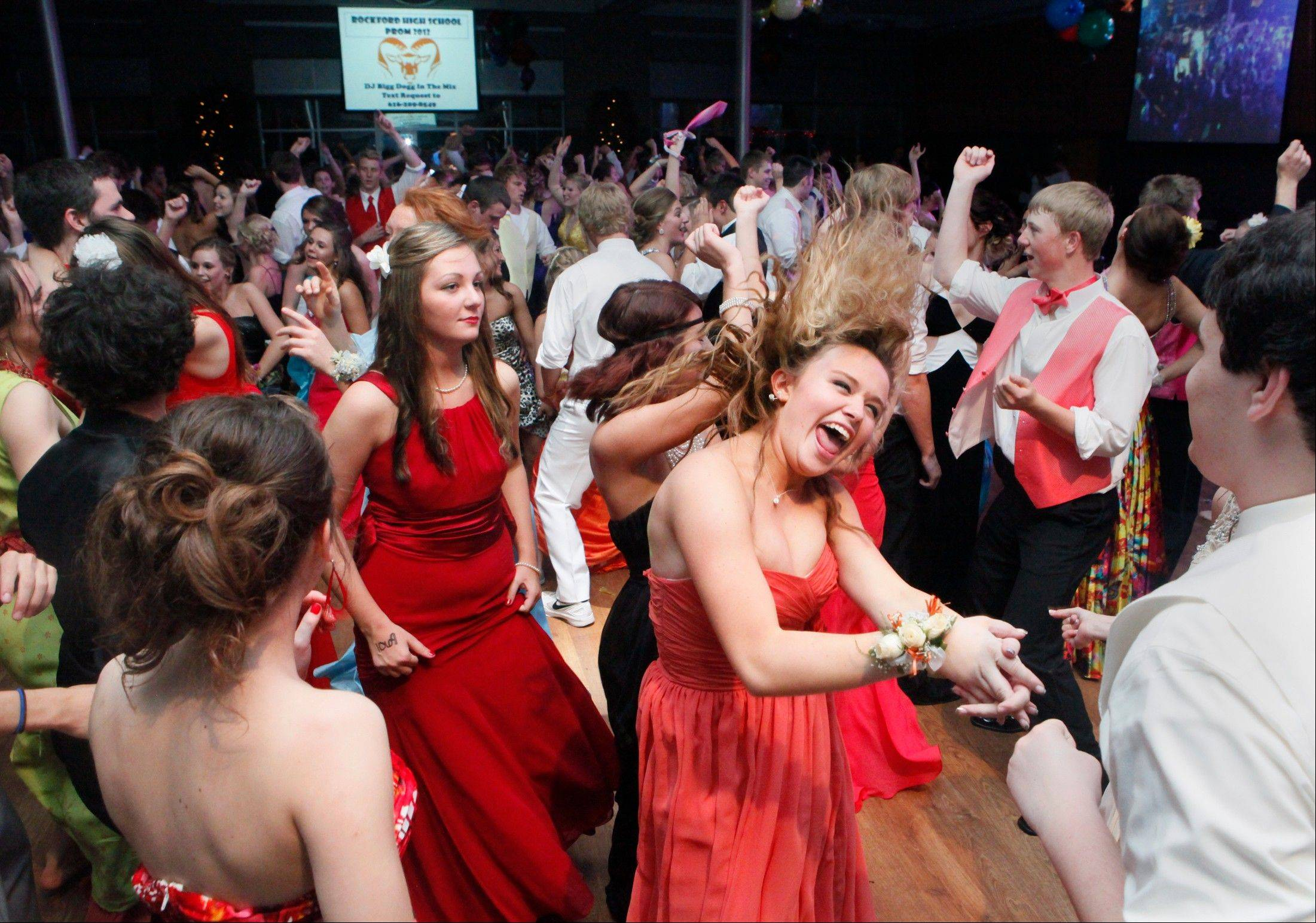 Rockford High School students dance at The Pinnacle Center during their prom in Hudsonville, Mich. Prom spending is expected to rise in 2013 to an average $1,139.