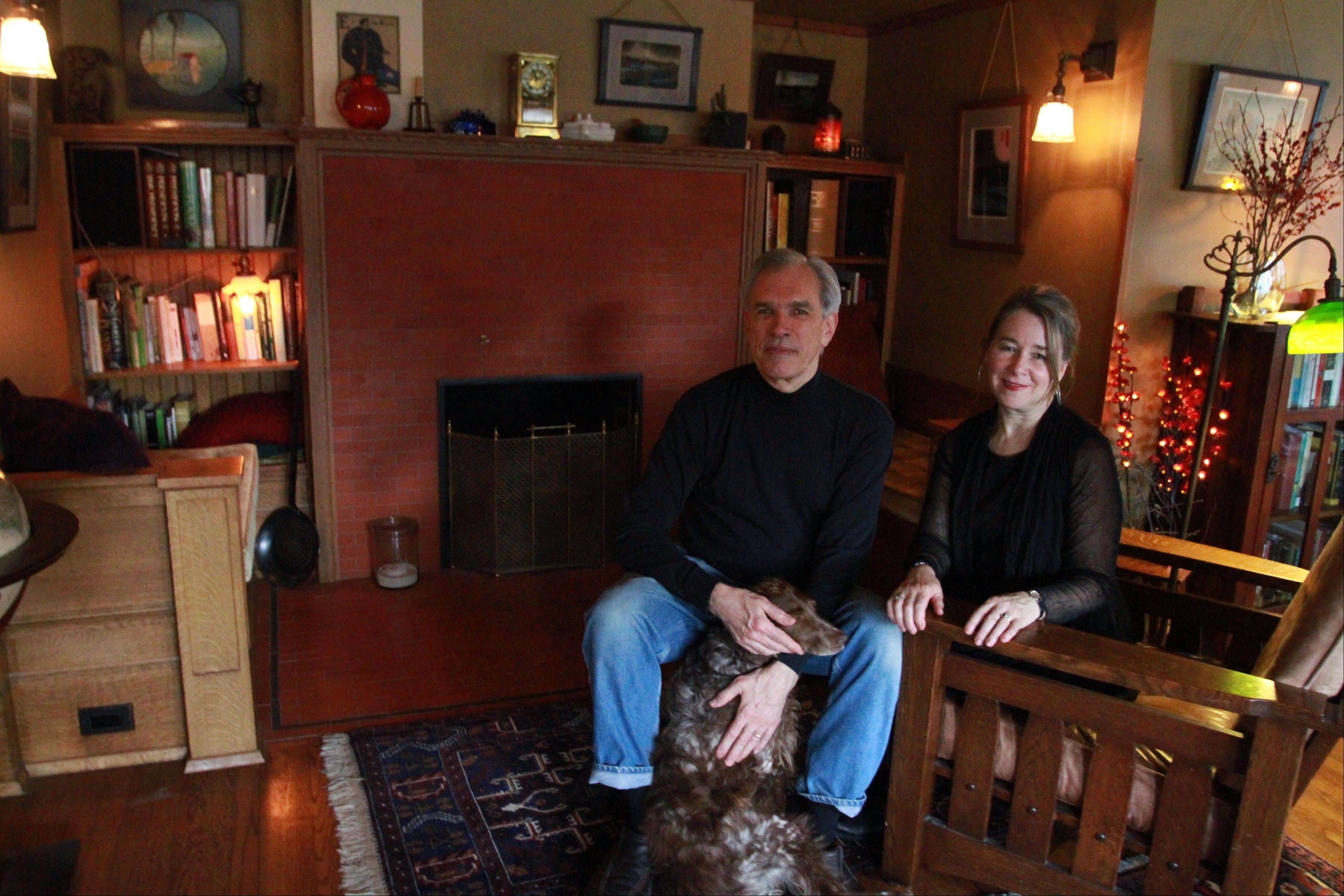 Mark Donovan and Mary Ludgin sit in front of the original inglenook at their Oak Park home, which was designed by Frank Lloyd Wright.