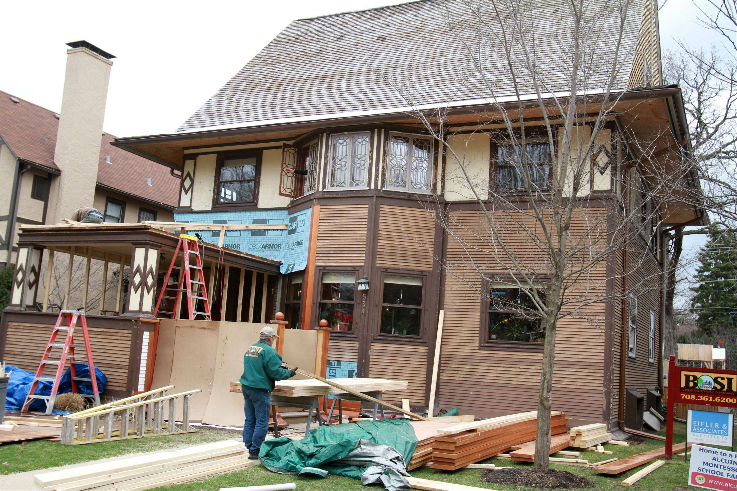 To prepare their home for this year's Wright Plus housewalk, Mark Donovan and Mary Ludgin are restoring the front porch, which was screened in at some point.