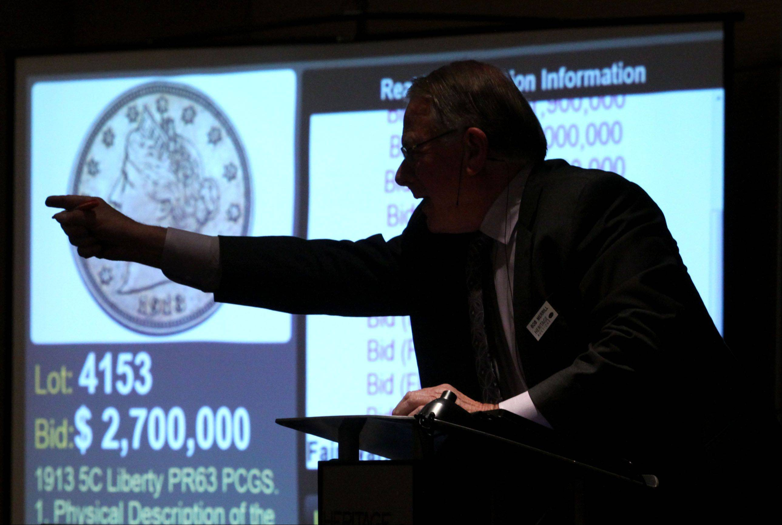 Auctioneer Bob Merrill of Heritage Auctions calls the winning bid at 2.7 million dollars as a 1913 Liberty Head Nickel - one of only five known to exist - was auctioned Thursday night during the Central States Numismatic Society show at the Schaumburg Convention Center.