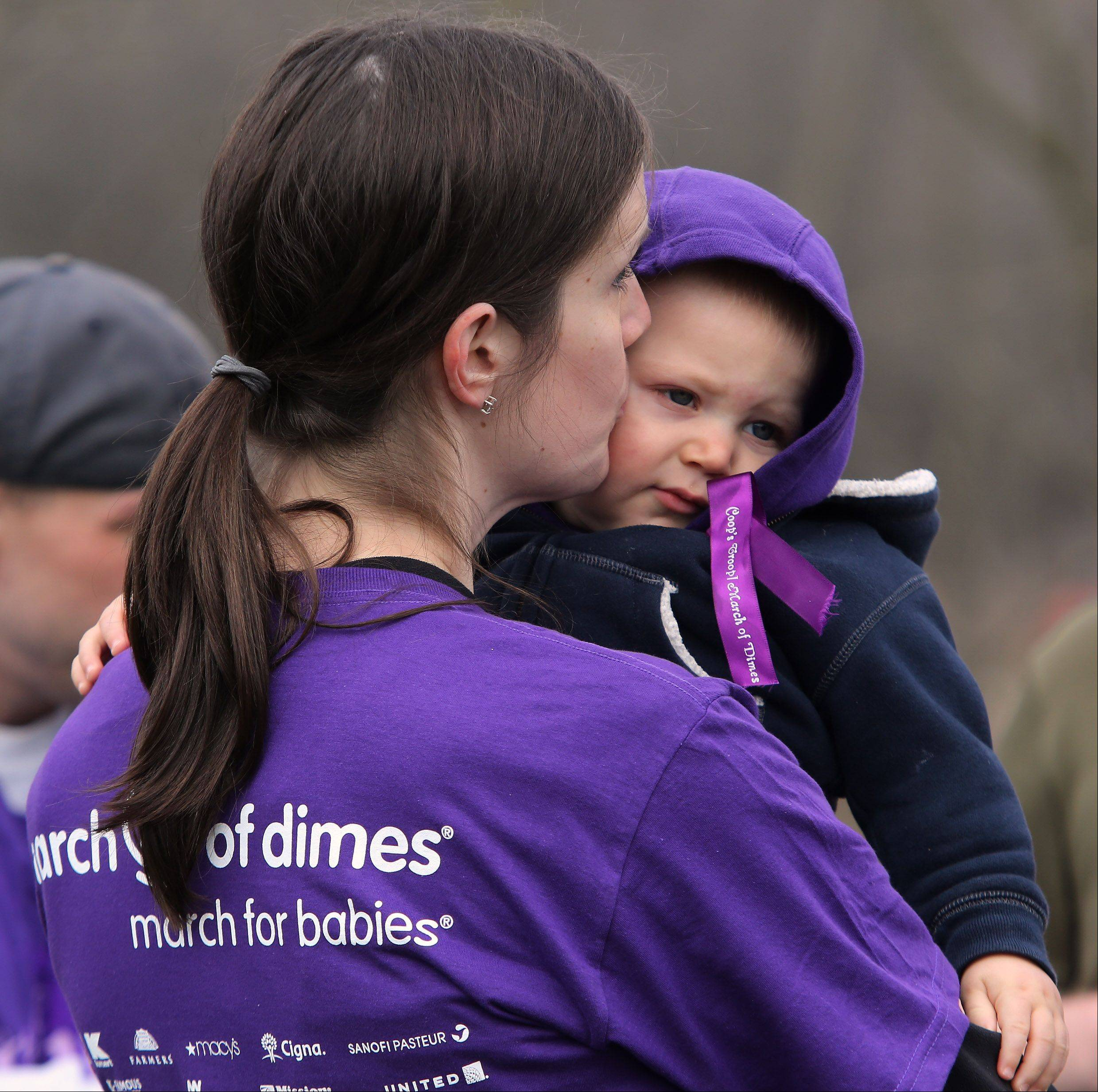 Jess Pruess, of Libertyville, kisses her 11-month-old son, Cooper before participating in the March of Dimes walk Sunday at Old School Forest Preserve near Libertyville. The March for Babies walk raises awareness and money for programs in Lake County to help understand and prevent premature birth and other serious problems that threaten babies.