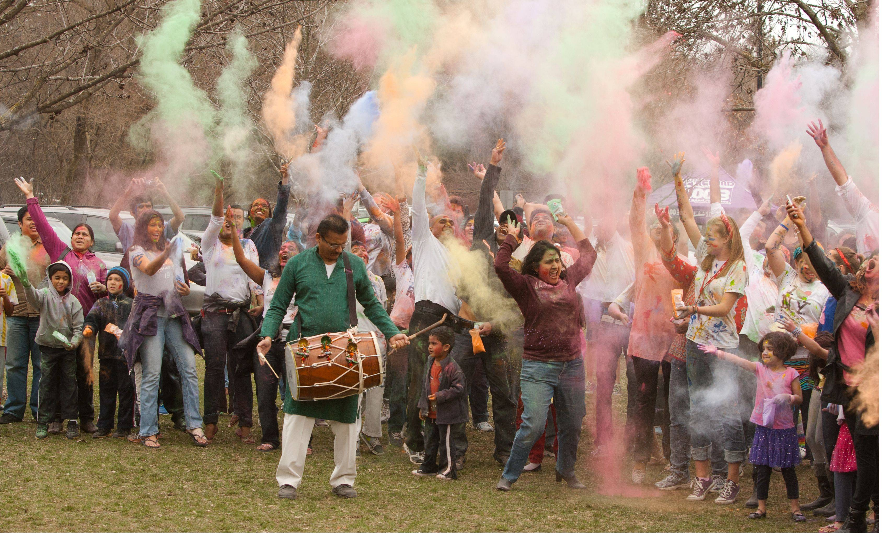 The Simply Vedic Cultural Society's celebration of the Festival of Colors marks the passing of winter and arrival of spring, during a recent event at the Grand Pavillion-Riverwalk in Naperville. Welcoming spring and turning over a new leaf, particpants throw their worries to the wind with bags of organic dry colors.