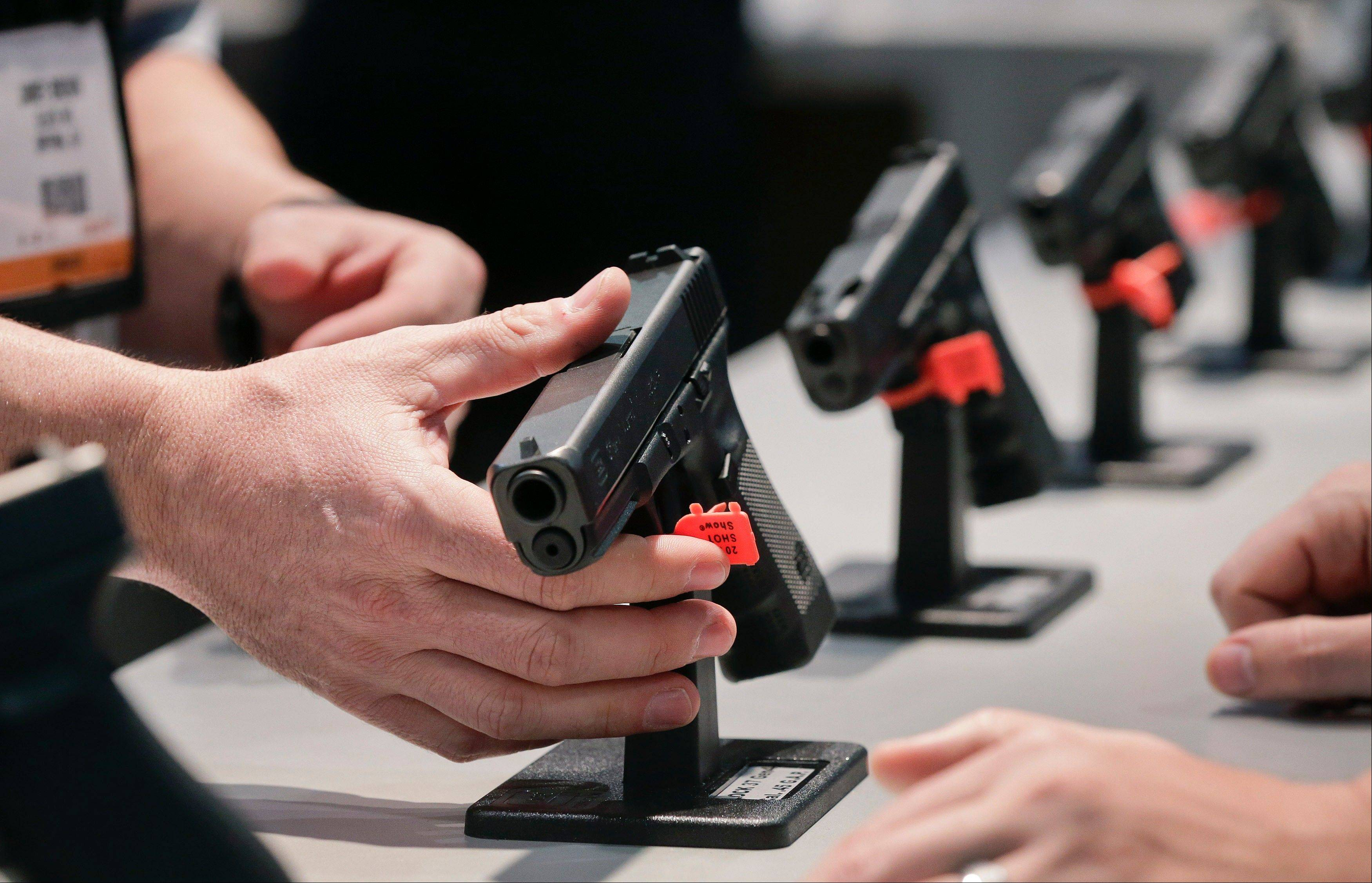 A Glock representative explains features of the Glock 37 Gen 4 .45 caliber pistol at the 35th annual SHOT Show in Las Vegas this past January.