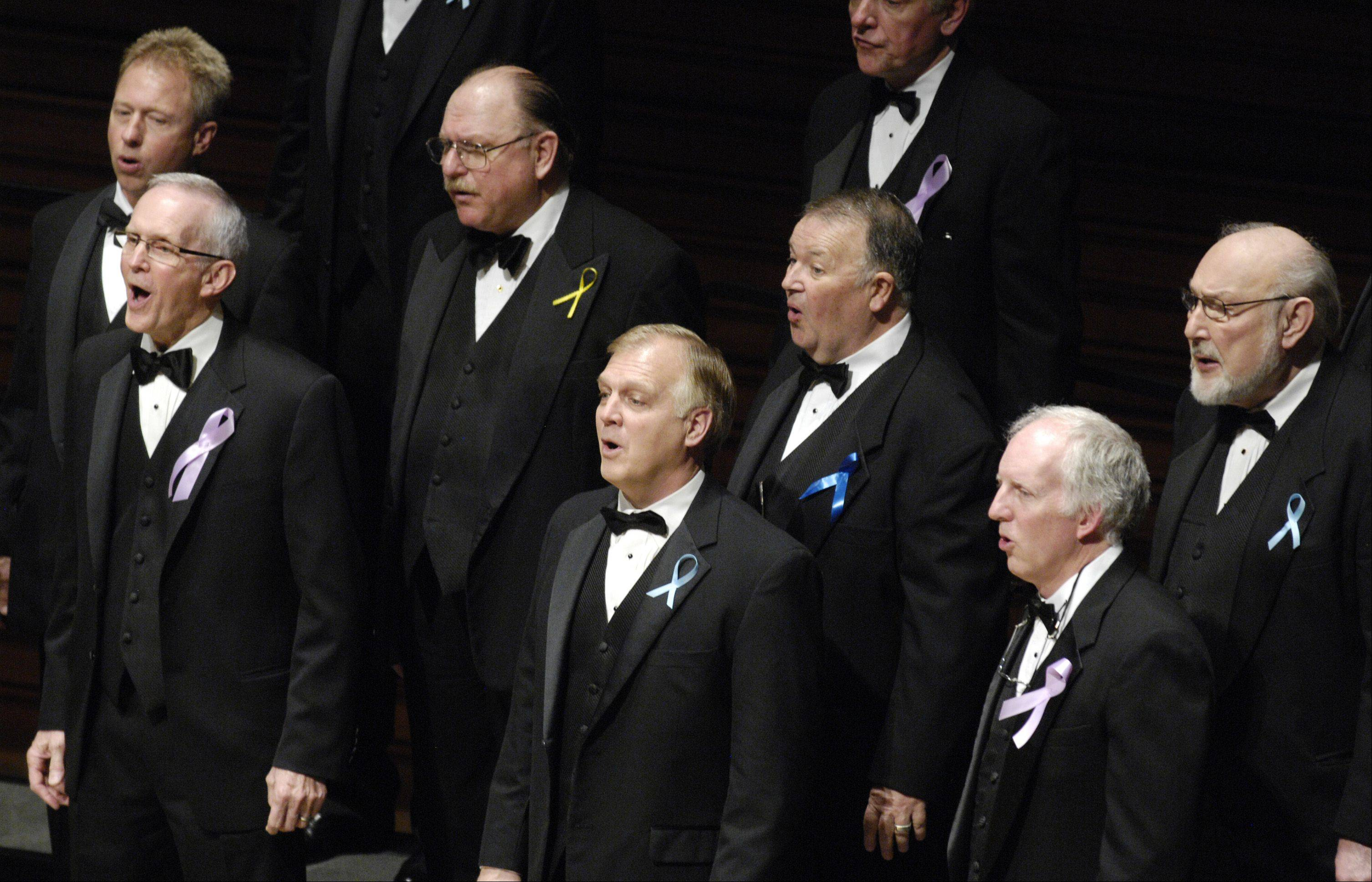 "The Naperville Men's Glee Club performs during the ""Voices of Hope"" concert Sunday at Wentz Concert Hall at North Central College in Naperville. It was a special concert for people whose lives were touched by cancer."