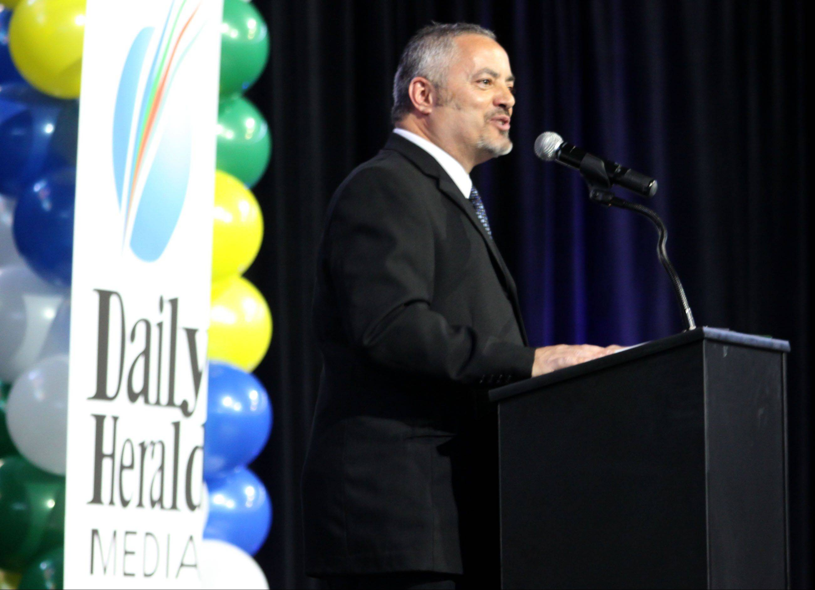 Daily Herald Lake County Sports Coordinator Joe Aguilar speaks during the Daily Herald Prep Sports Excellence Awards Ceremony at Sears Centre Arena in Hoffman Estates on Sunday.