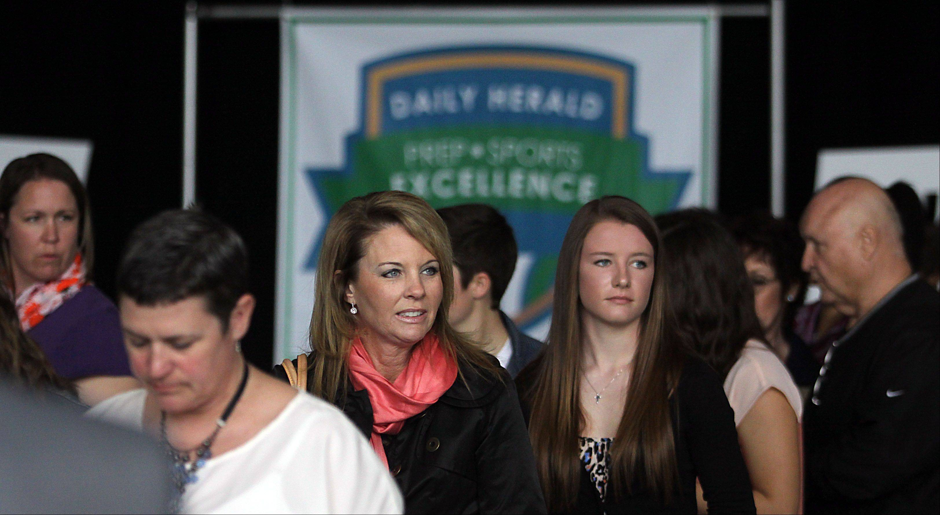 Participants and honorees arrive during the Daily Herald Prep Sports Excellence Awards Ceremony at Sears Centre Arena in Hoffman Estates on Sunday.