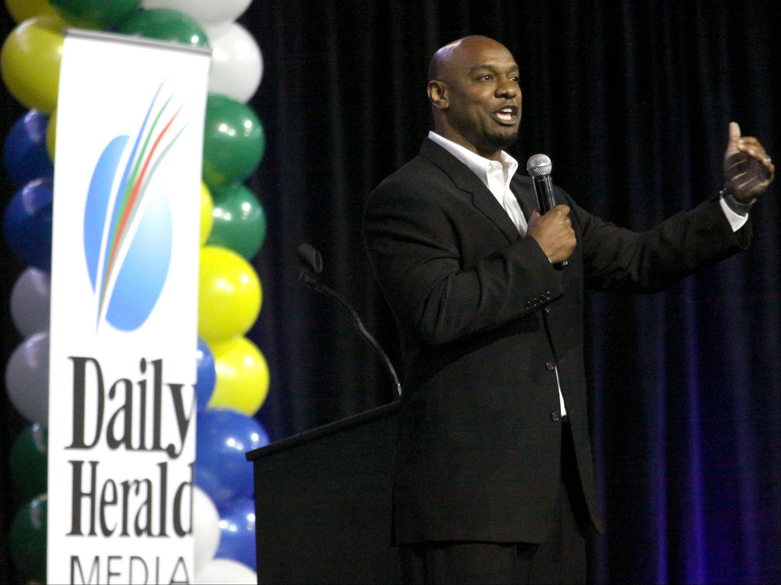 Jarrett Payton, keynote speaker, offers his remarks during the Daily Herald Prep Sports Excellence Awards Ceremony at Sears Centre Arena in Hoffman Estates on Sunday.