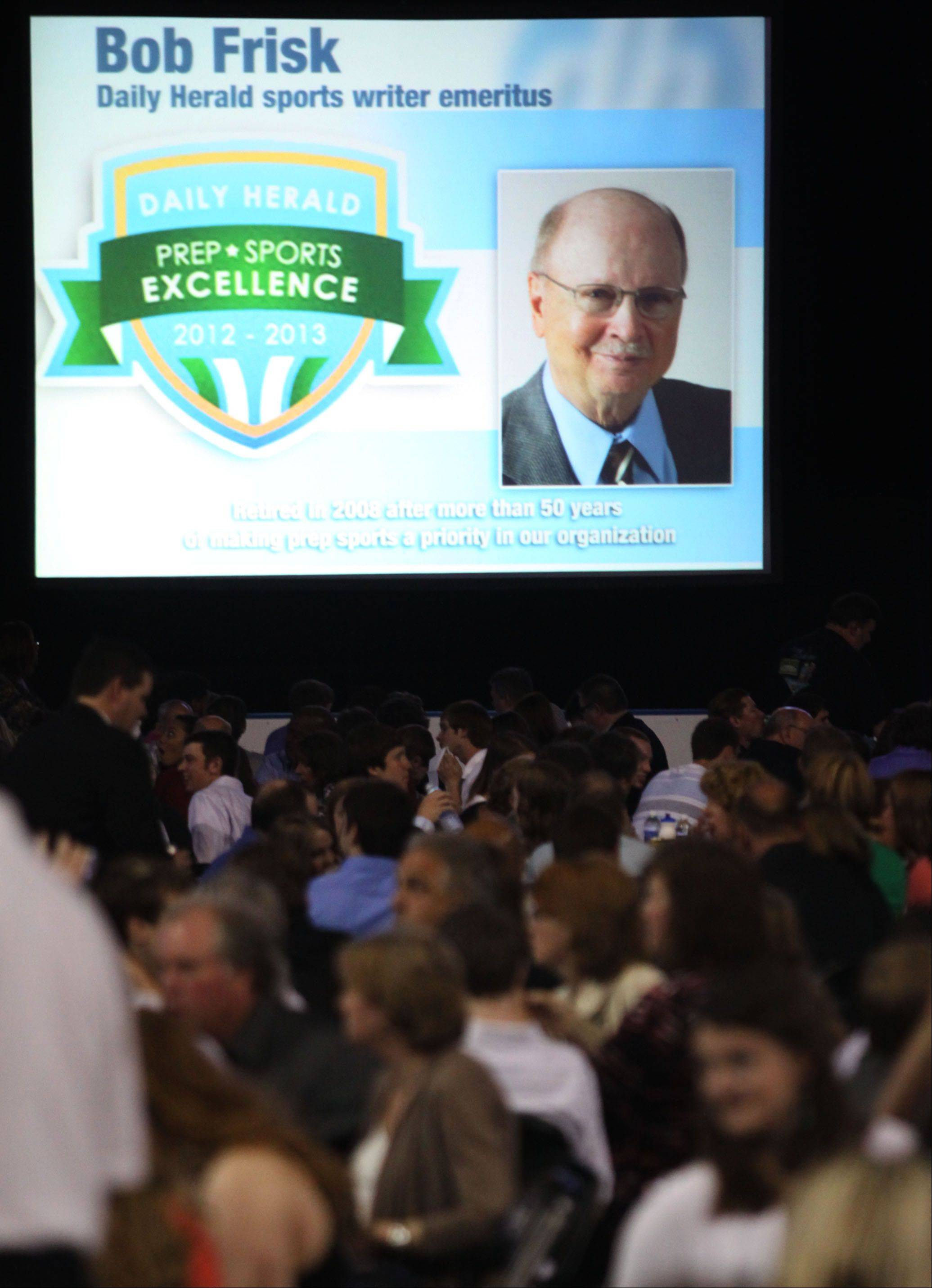 A frame honoring retired Daily Herald Prep Sports Editor Bob Frisk is shown during the Prep Sports Excellence Awards Ceremony at Sears Centre Arena in Hoffman Estates on Sunday.