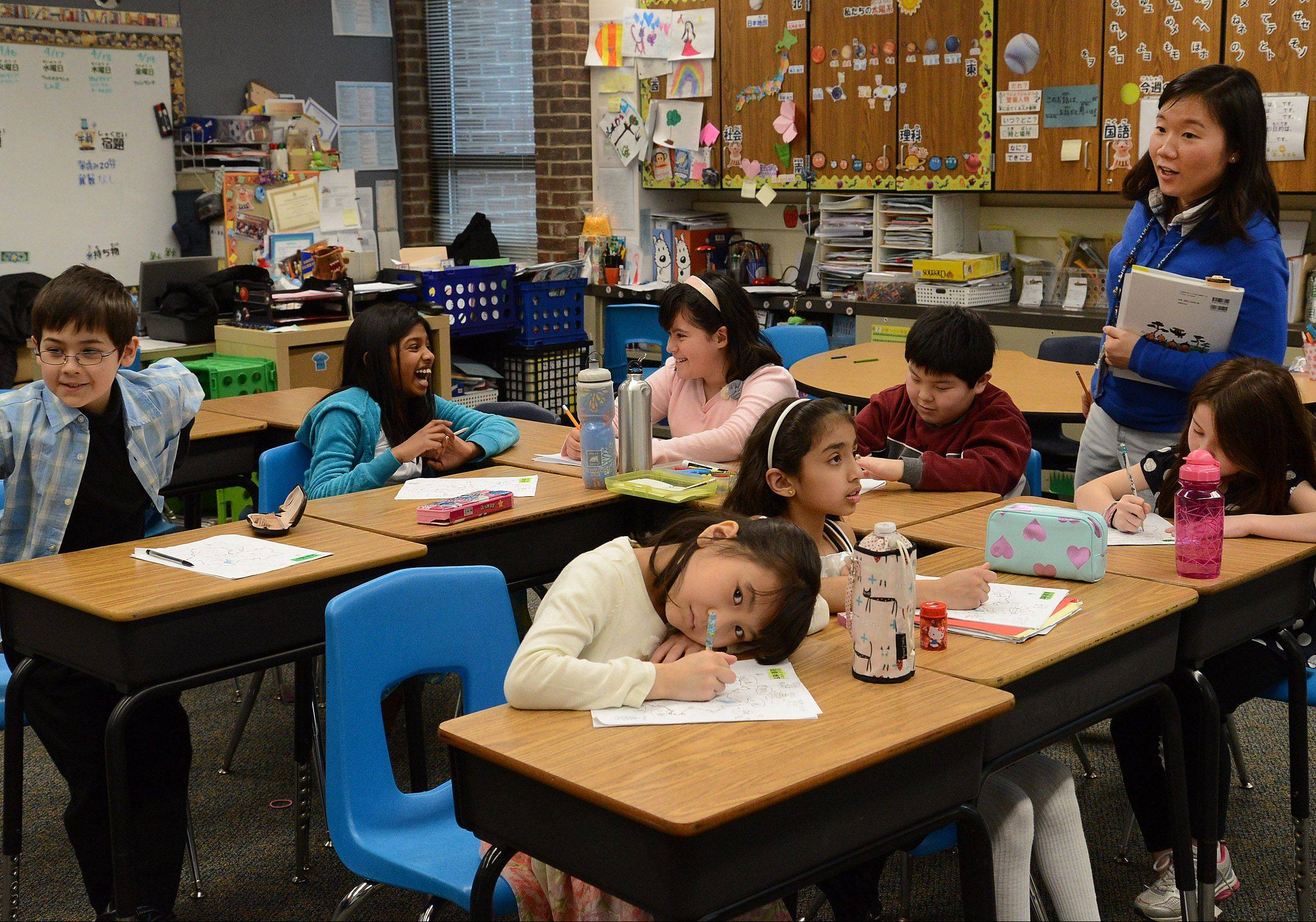 Sachi Takahashi teaches a class of third-graders in Dooley Elementary School's dual language program in Schaumburg, which offers Japanese- and English-speaking students the opportunity to become biliterate, bilingual and bicultural.