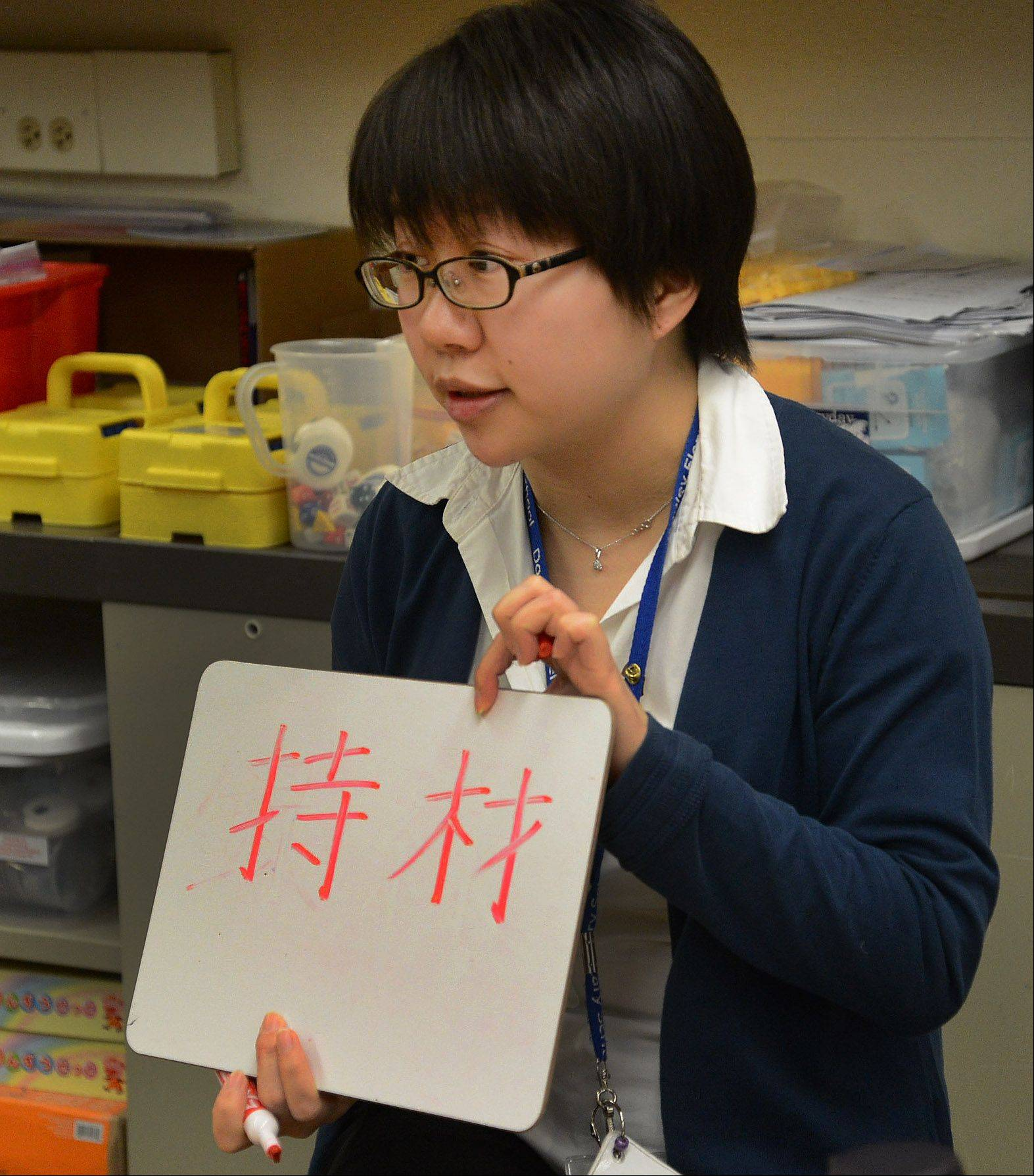 Naoko Sanders teaches a class of fourth-graders in Dooley Elementary School's dual language program in Schaumburg, which offers Japanese- and English-speaking students the opportunity to become biliterate, bilingual and bicultural.