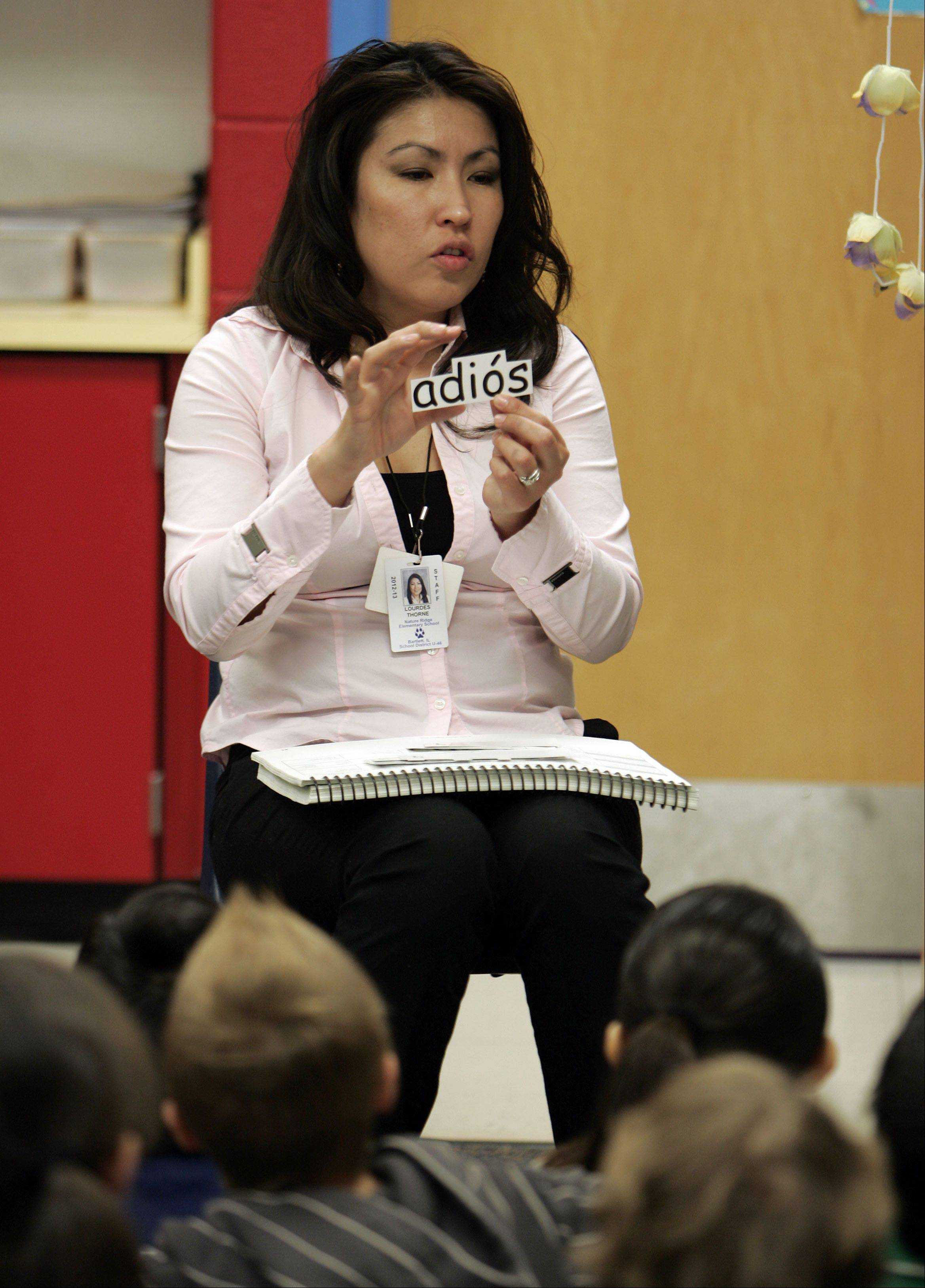Nature Ridge Elementary School first-grade teacher Lourdes Thorne works with her dual language class in Bartlett.