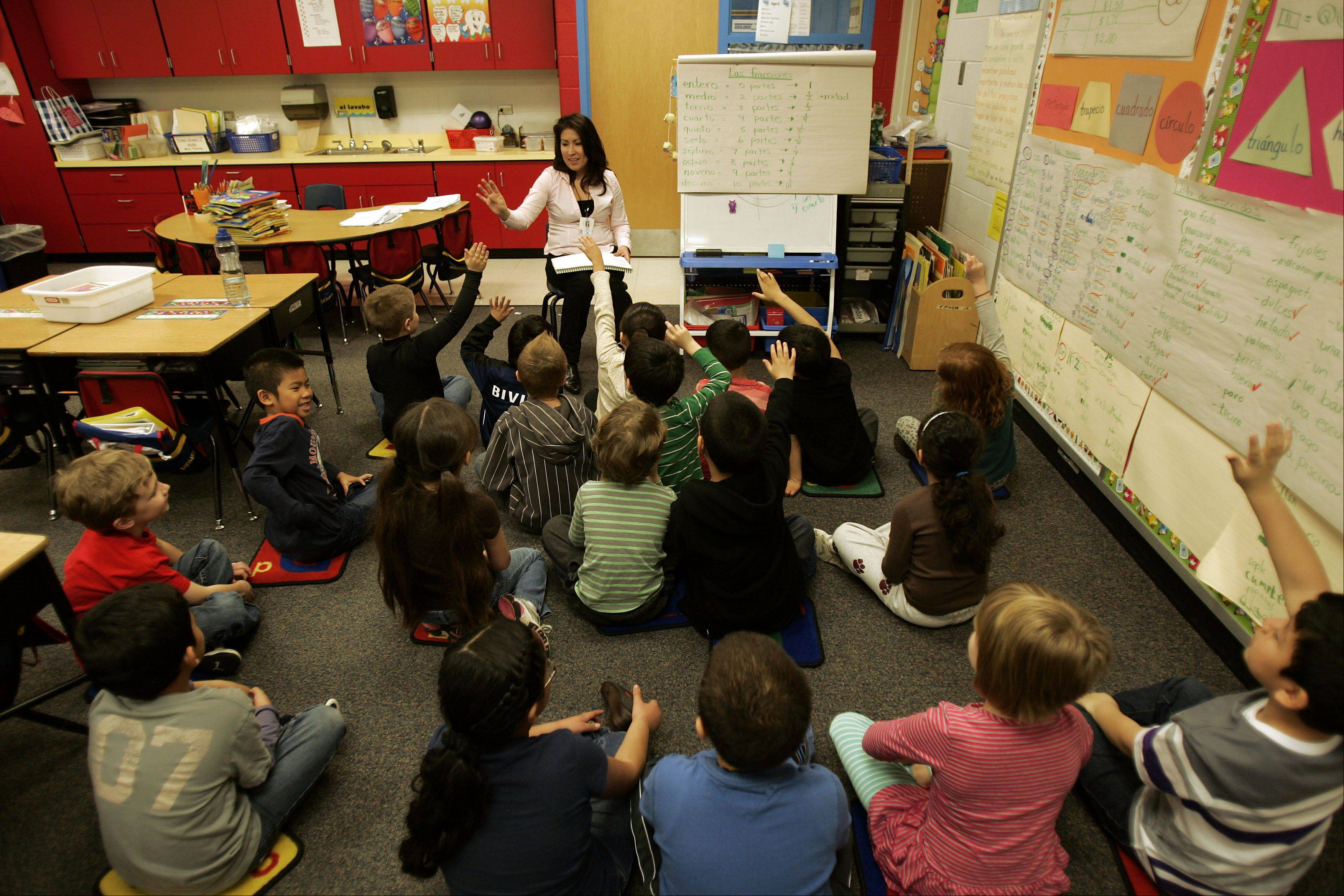 Nature Ridge Elementary School first grade teacher Lourdes Thorne works with her dual language class in Bartlett.