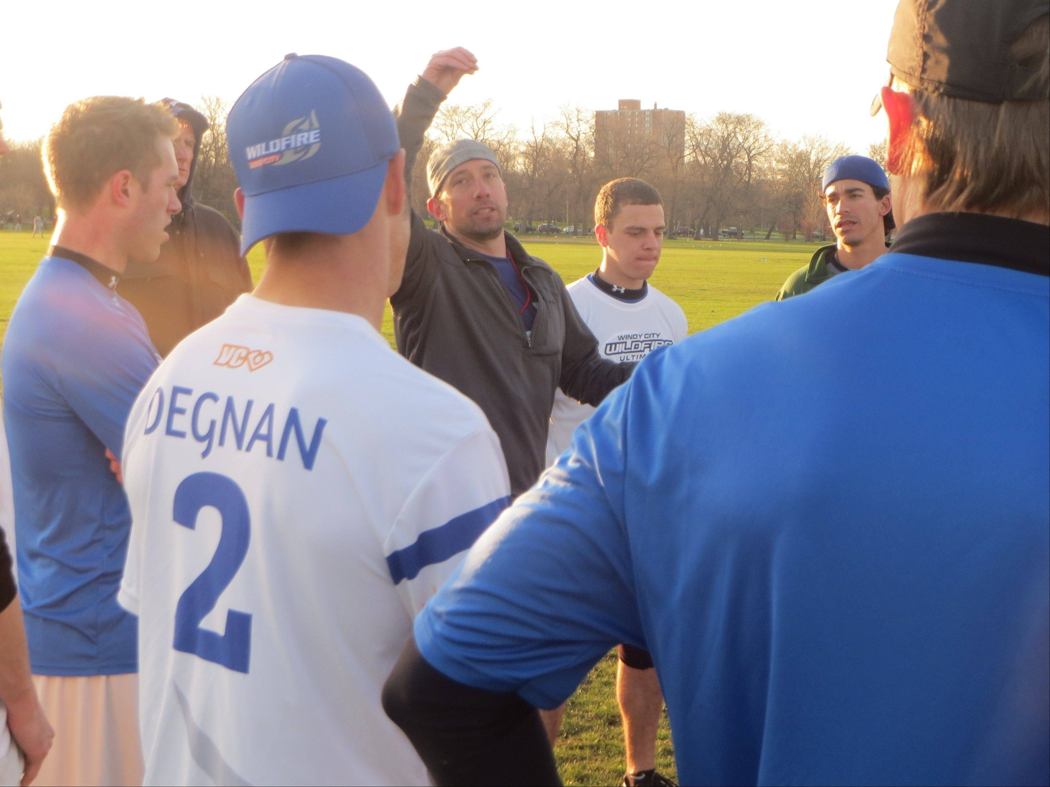 Demonstrating a technique used in the game of Ultimate, legendary player and Warrenville native Ron Kubalanza (with arm raised) dishes out advice to his fellow teammates on the Windy City Wildfire, Chicago's new sports franchise in the American Ultimate Disc League.