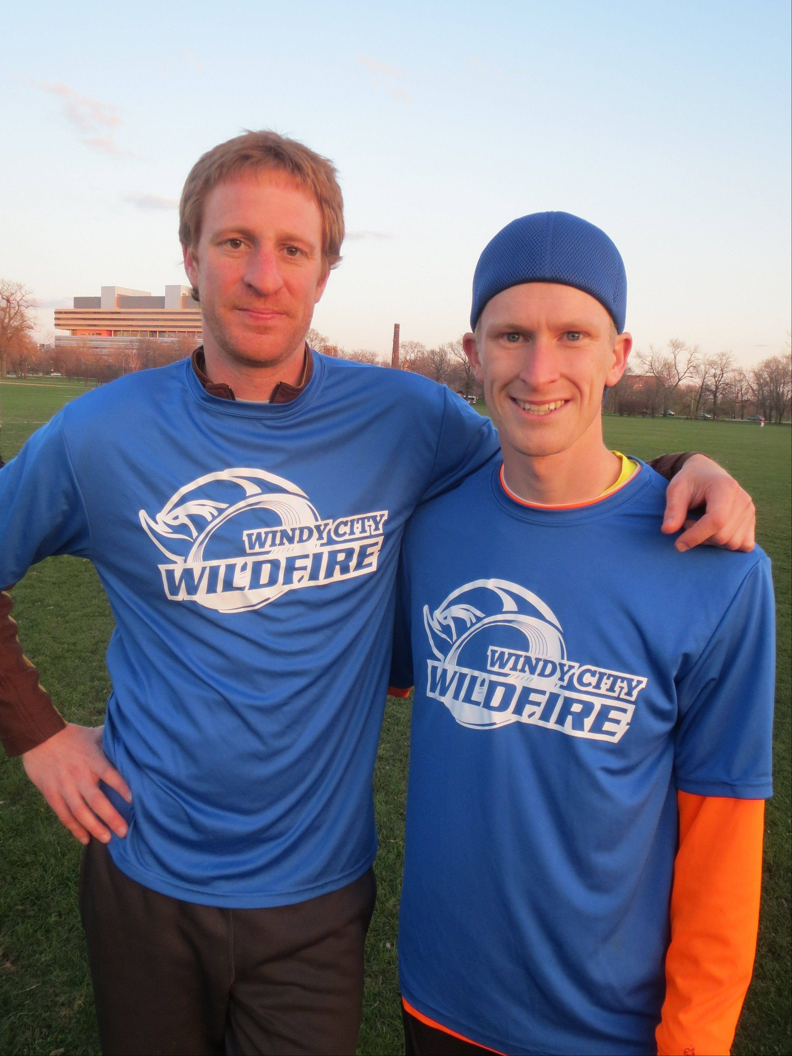 Teammates on Chicago's newest professional sports team, Brett Kolinek, left, of Naperville, and Jimmy Robin of Hawthorn Woods, take a break during a high-energy practice of catching, throwing and sprinting to prepare for Sunday's American Ultimate Disc League game.