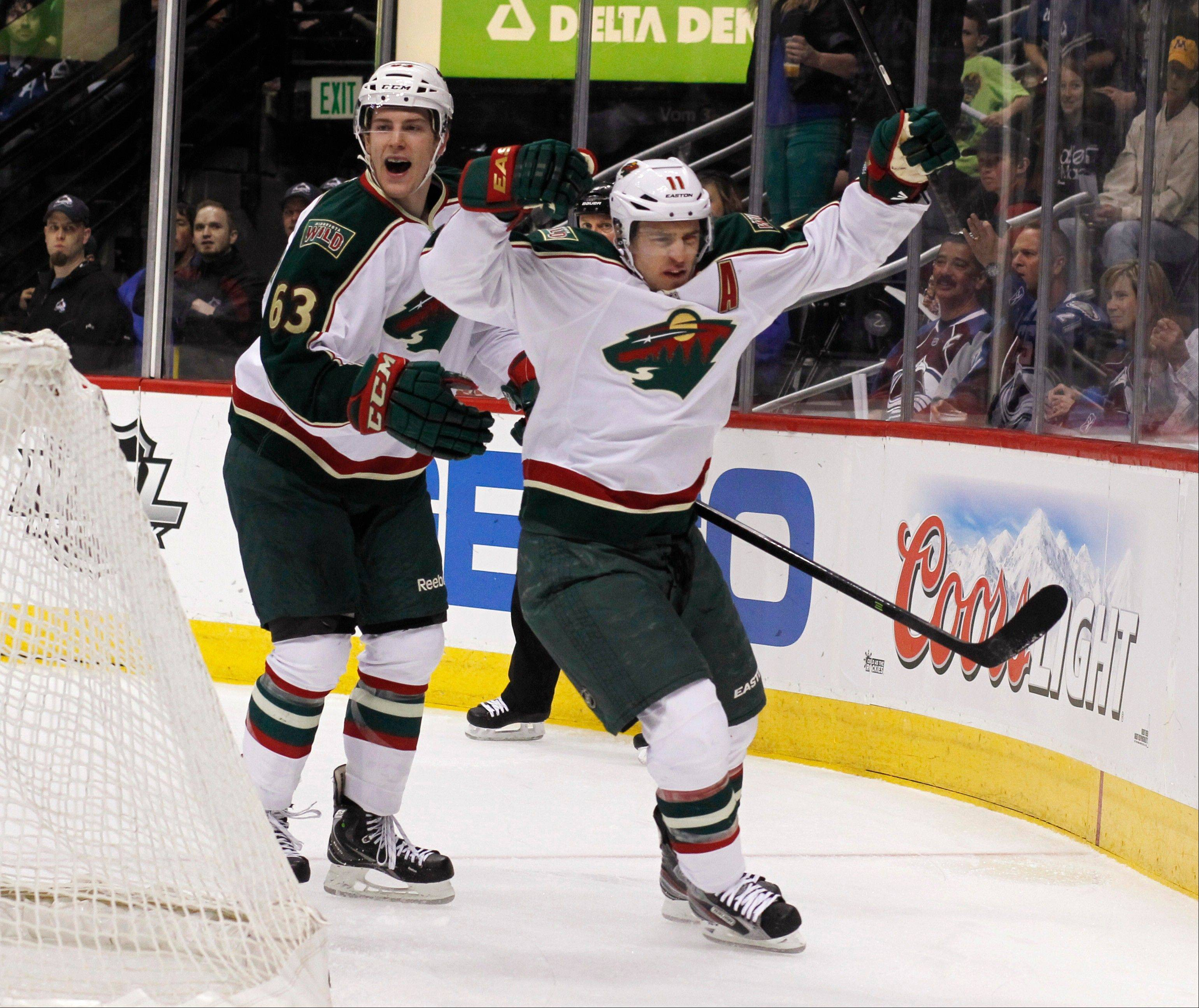 Minnesota Wild left wing Zach Parise, front, celebrates his goal with right wing Charlie Coyle against the Colorado Avalanche in the first period of an NHL hockey game in Denver on Saturday, April 27, 2013.