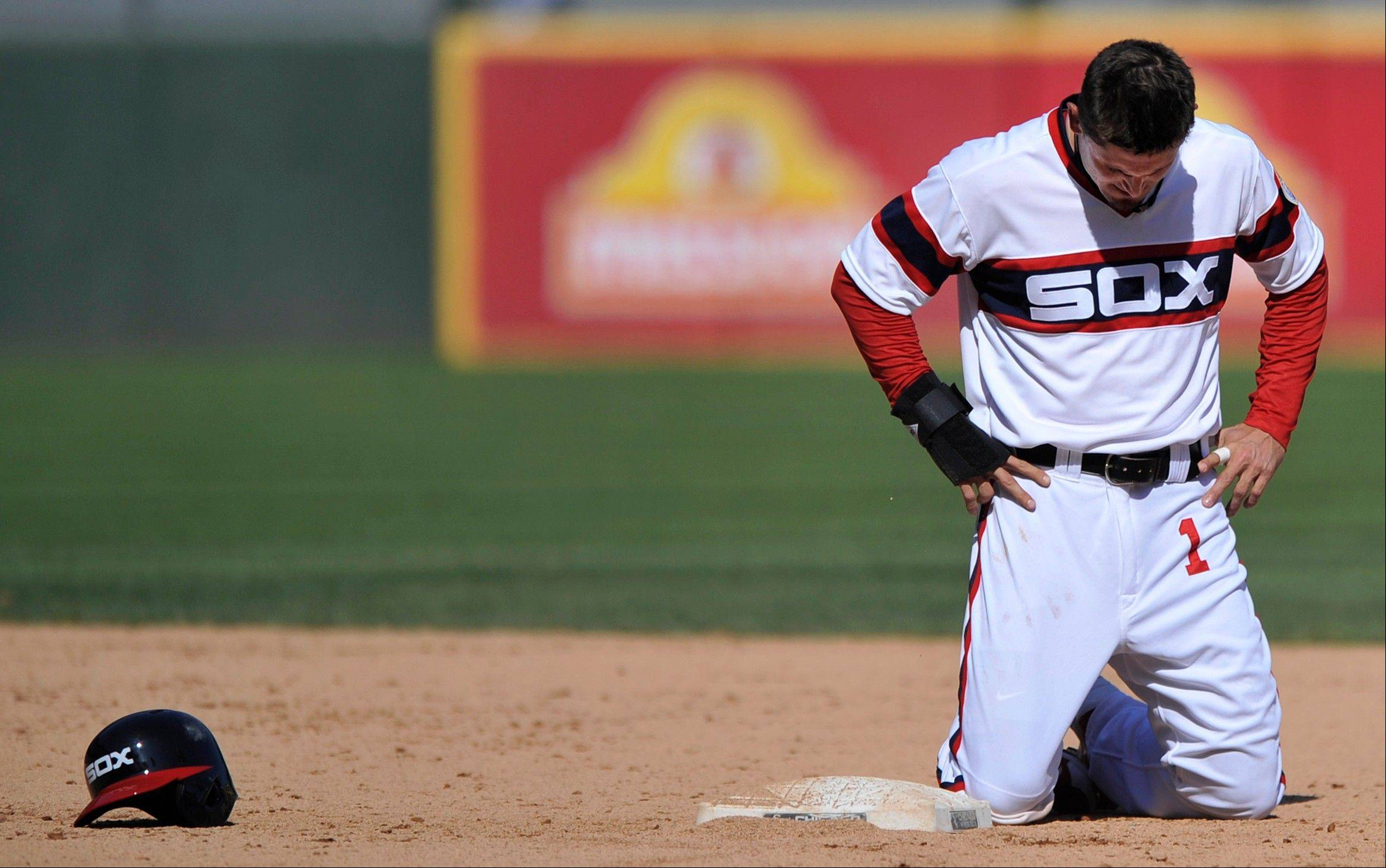 Tyler Greene reacts after being forced out at second base by Tampa Bay second baseman Ryan Roberts during the eighth inning of an MLB baseball game in Chicago, Sunday, April 28, 2013. Tampa won 8-3.