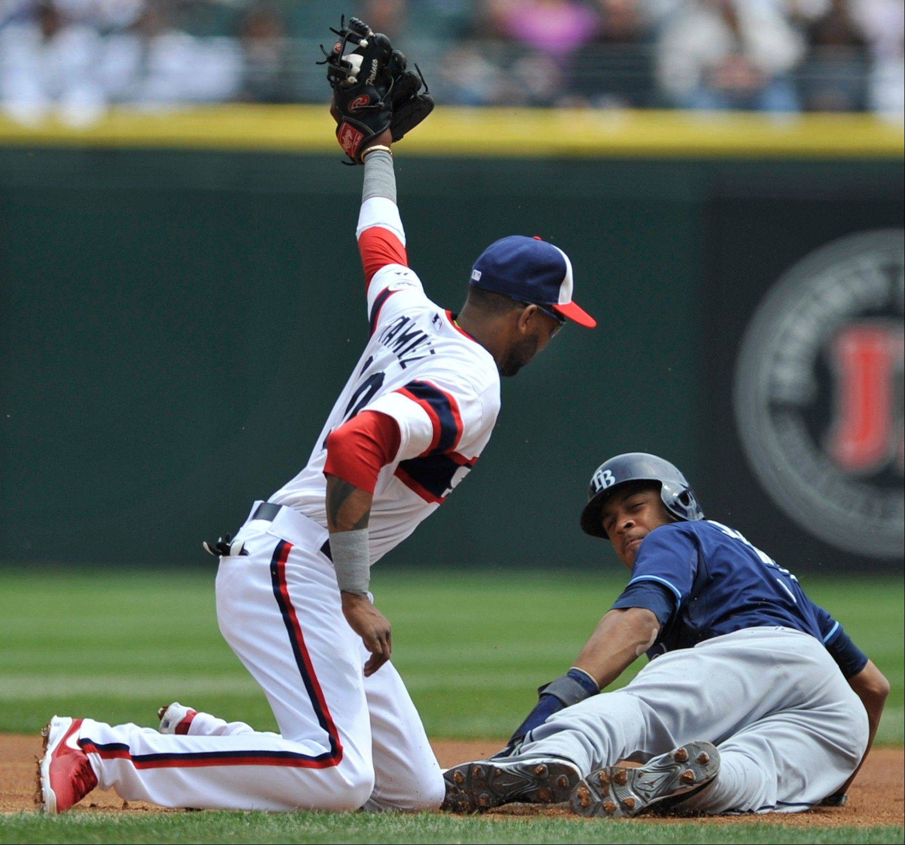 Chicago White Sox shortstop Alexei Ramirez, left, tags out Tampa Bay Rays' Desmond Jennings who was attempting to steal second base during the first inning of a baseball game in Chicago, Sunday, April 28, 2013.