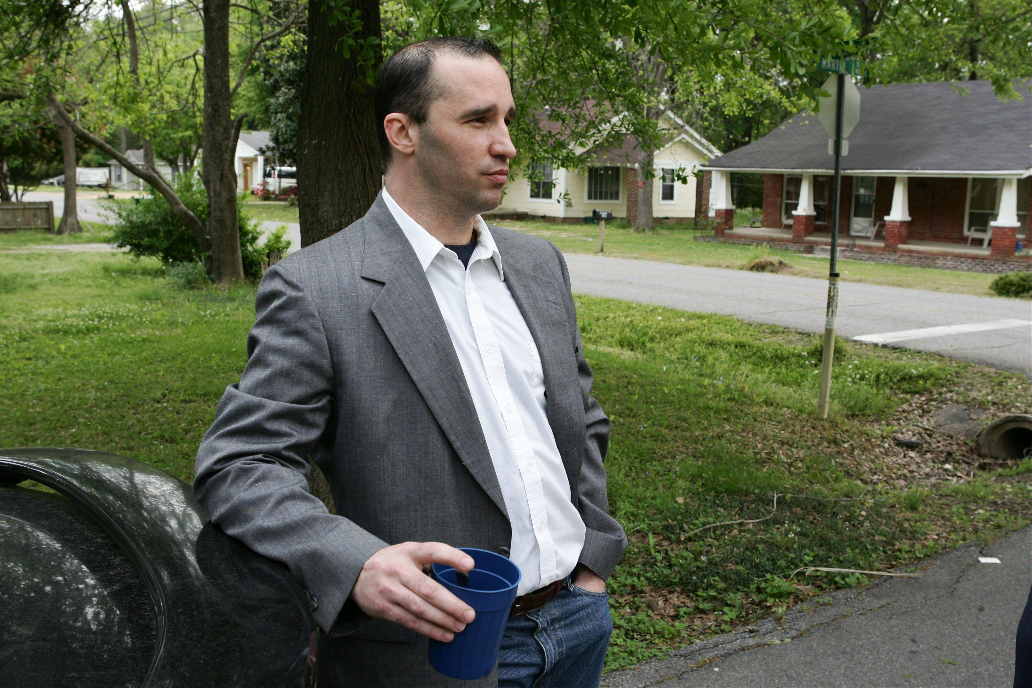 Everett Dutschke stands in the street near his home in Tupelo, Miss., and waits for the FBI to arrive and search his home. Dutschke, charged with making and possessing ricin as part of the investigation into poison-laced letters sent to President Barack Obama and others, is expected to appear in court Monday.