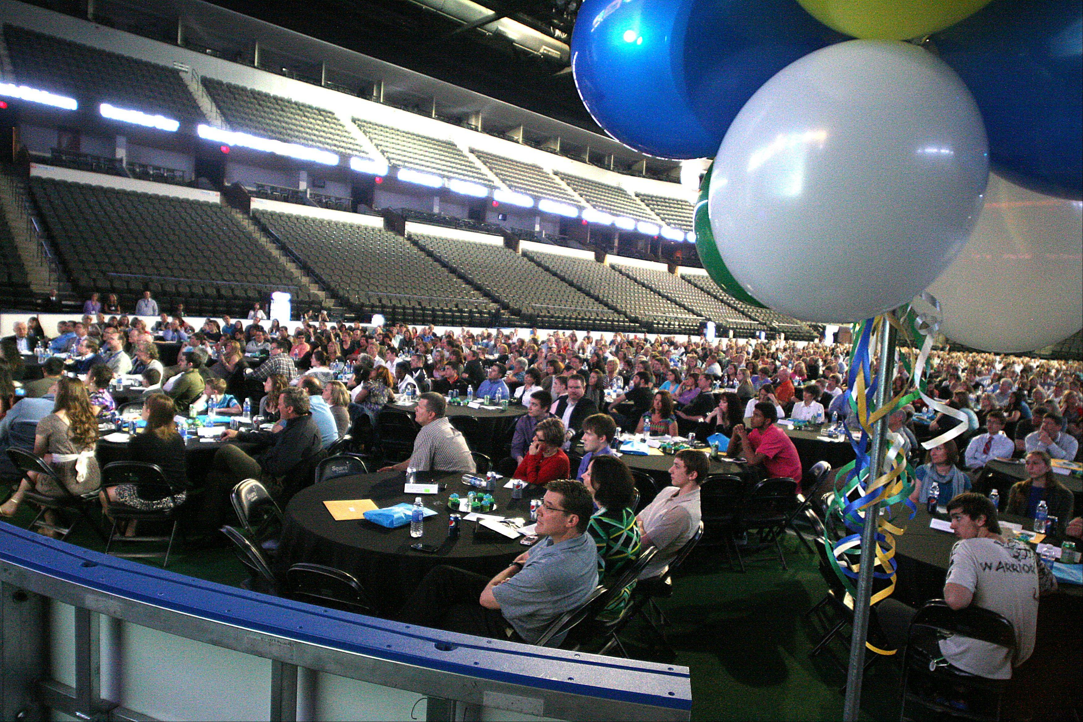 Stdent-athletes and their families participate during the Daily Herald Prep Sports Excellence Awards Ceremony at Sears Centre Arena in Hoffman Estates on Sunday.