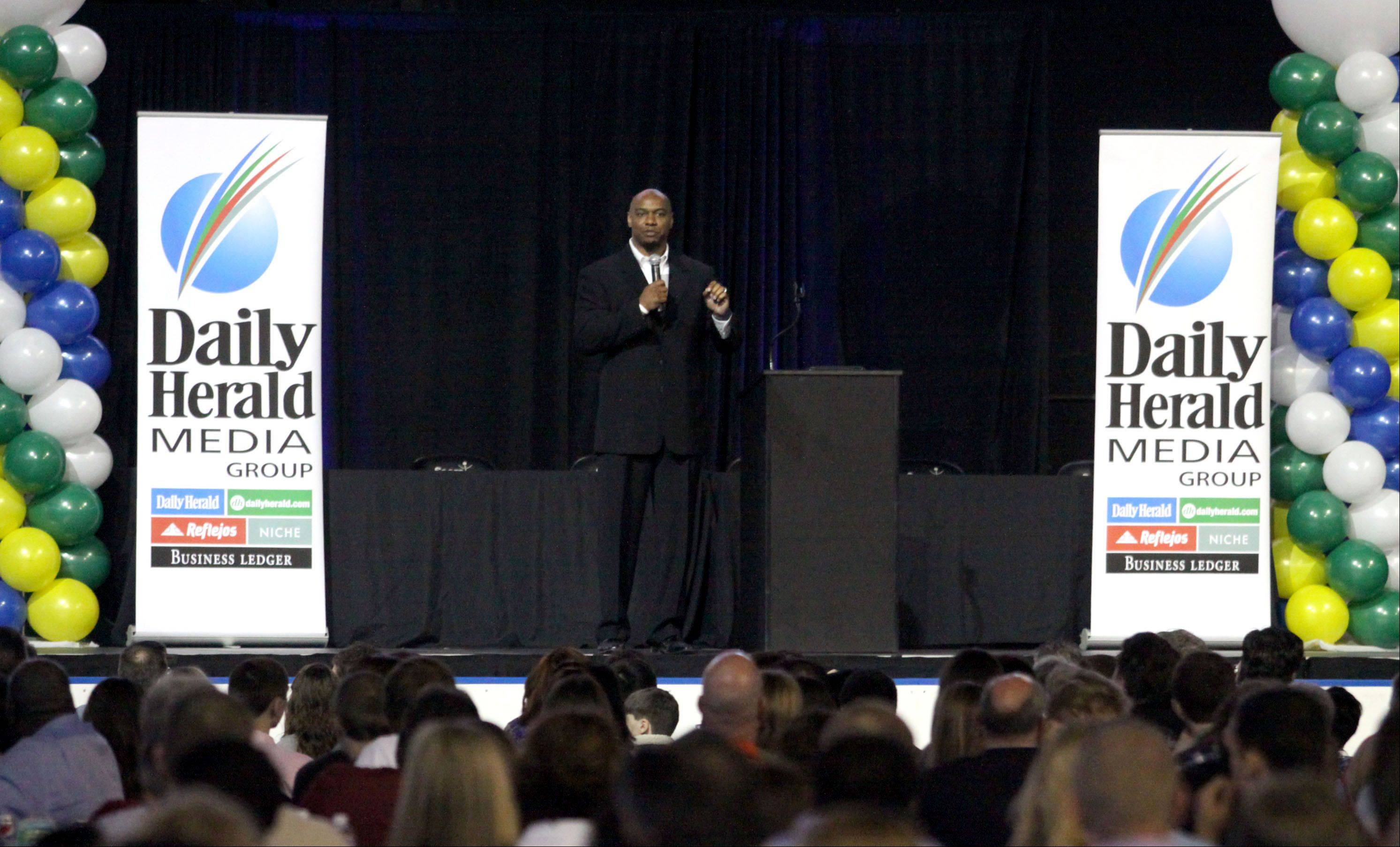 Patrick Kunzer/pkunzer@dailyherald.com Jarrett Payton, keynote speaker, offers his remarks during the Daily Herald Prep Sports Excellence Awards Ceremony at Sears Centre Arena in Hoffman Estates on Sunday.