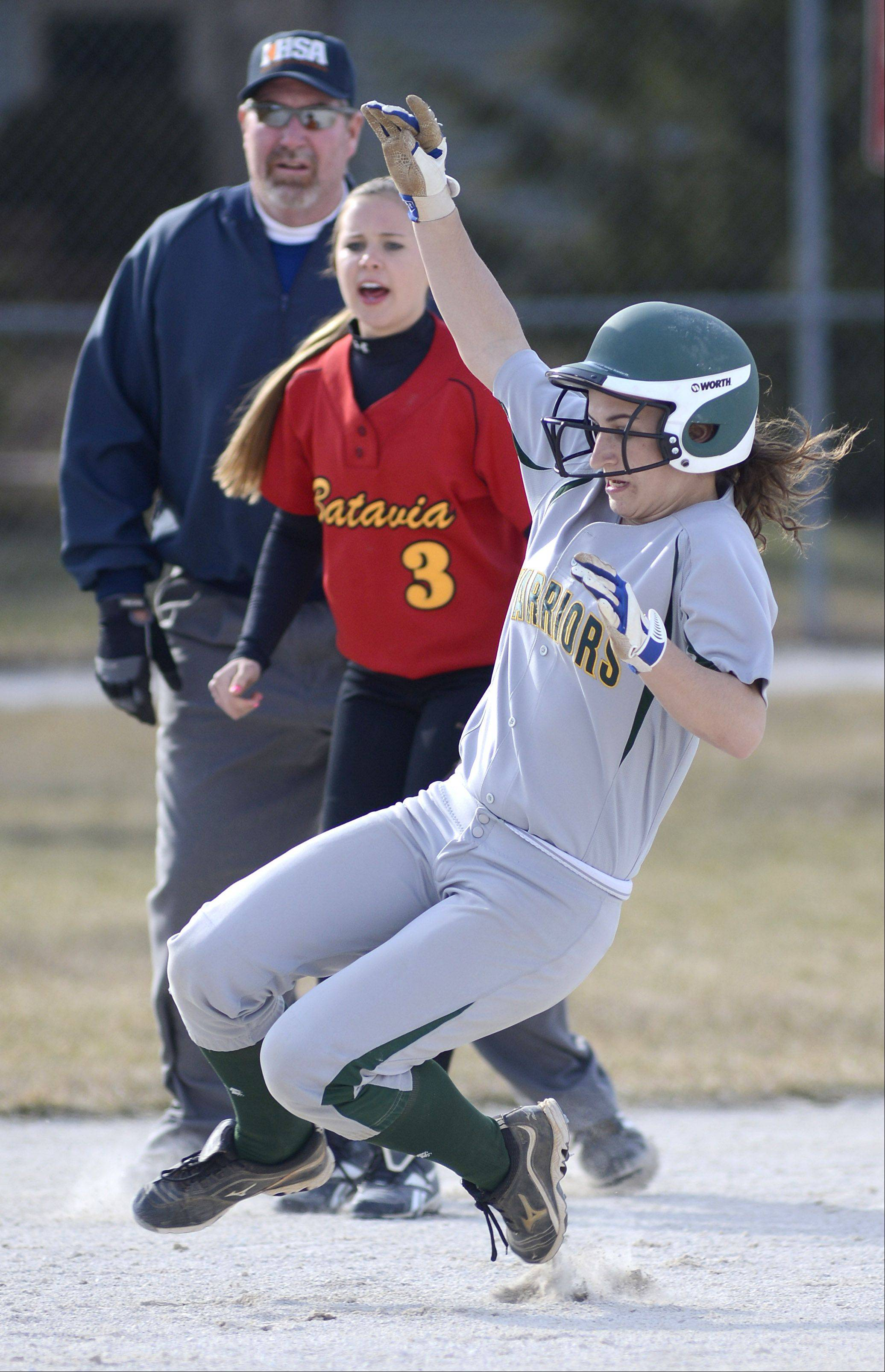 Waubonsie Valley�s Amanda Minahan preps to slide safely into second base past Batavia�s Lauren Mueller in the first inning on Friday, April 5.
